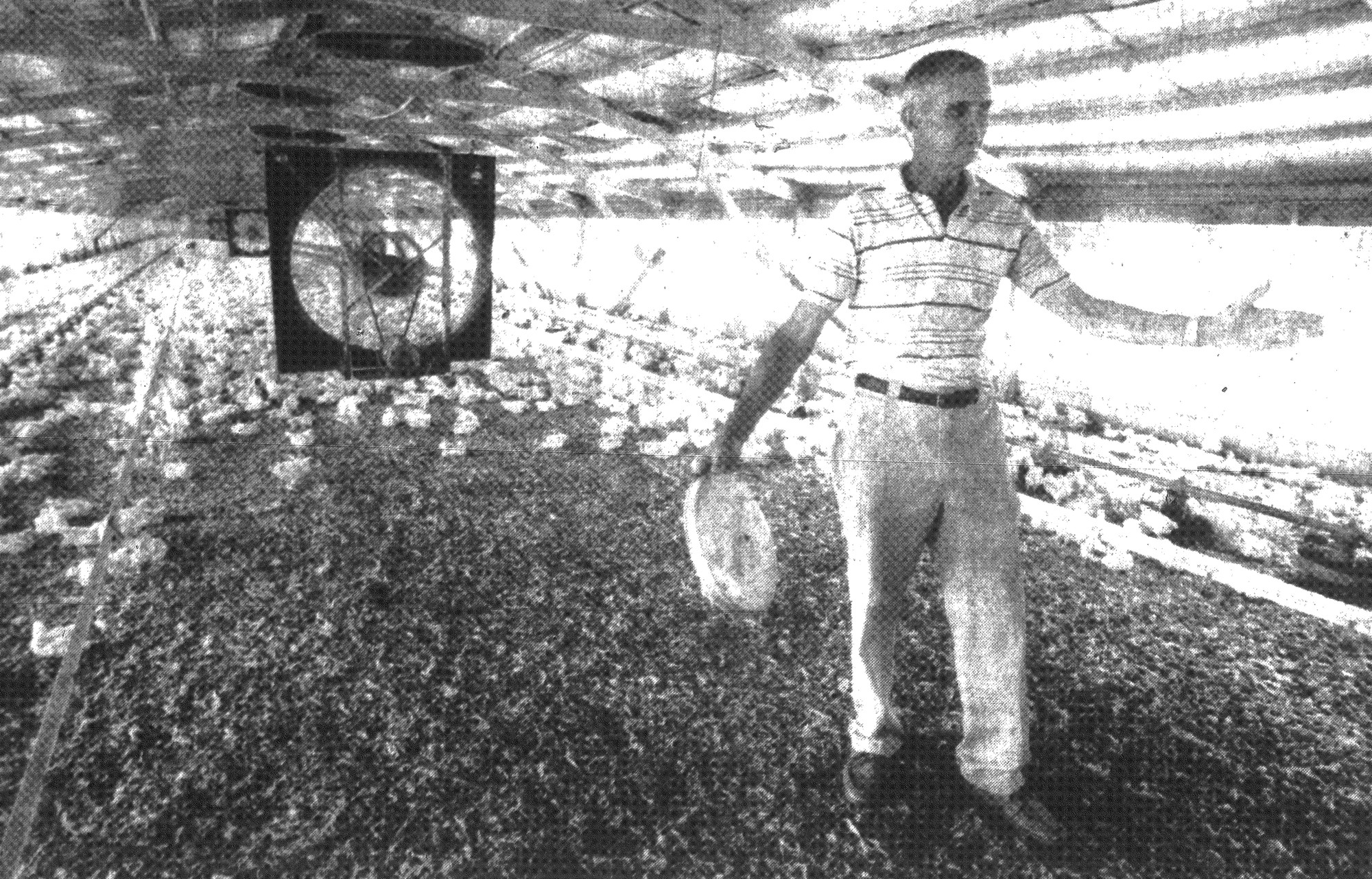 1993 - Gilbert Barkley checks the temperature in one of his chicken coops. During the first week of July, he lost 3,000 chickens when temperatures averaged 100 degrees every day. Barkley sells chickens to Carolina Golden Products.