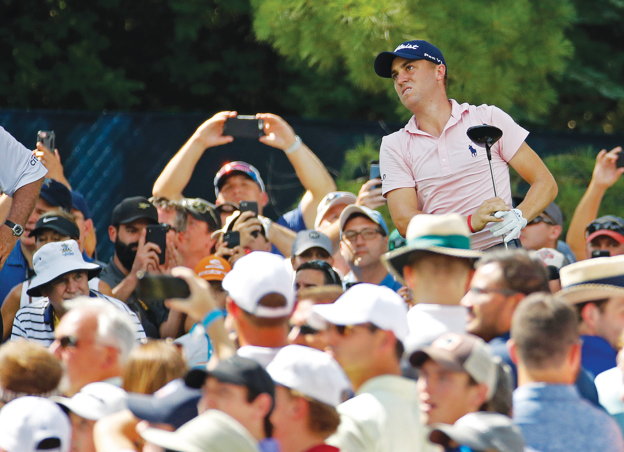 Justin Thomas watches his tee shot on the 15th hole during a practice round for the PGA  Championship at Bellerive Country Club on Wednesday in St. Louis. Thomas will be trying to defend his title when the tournament begins today.