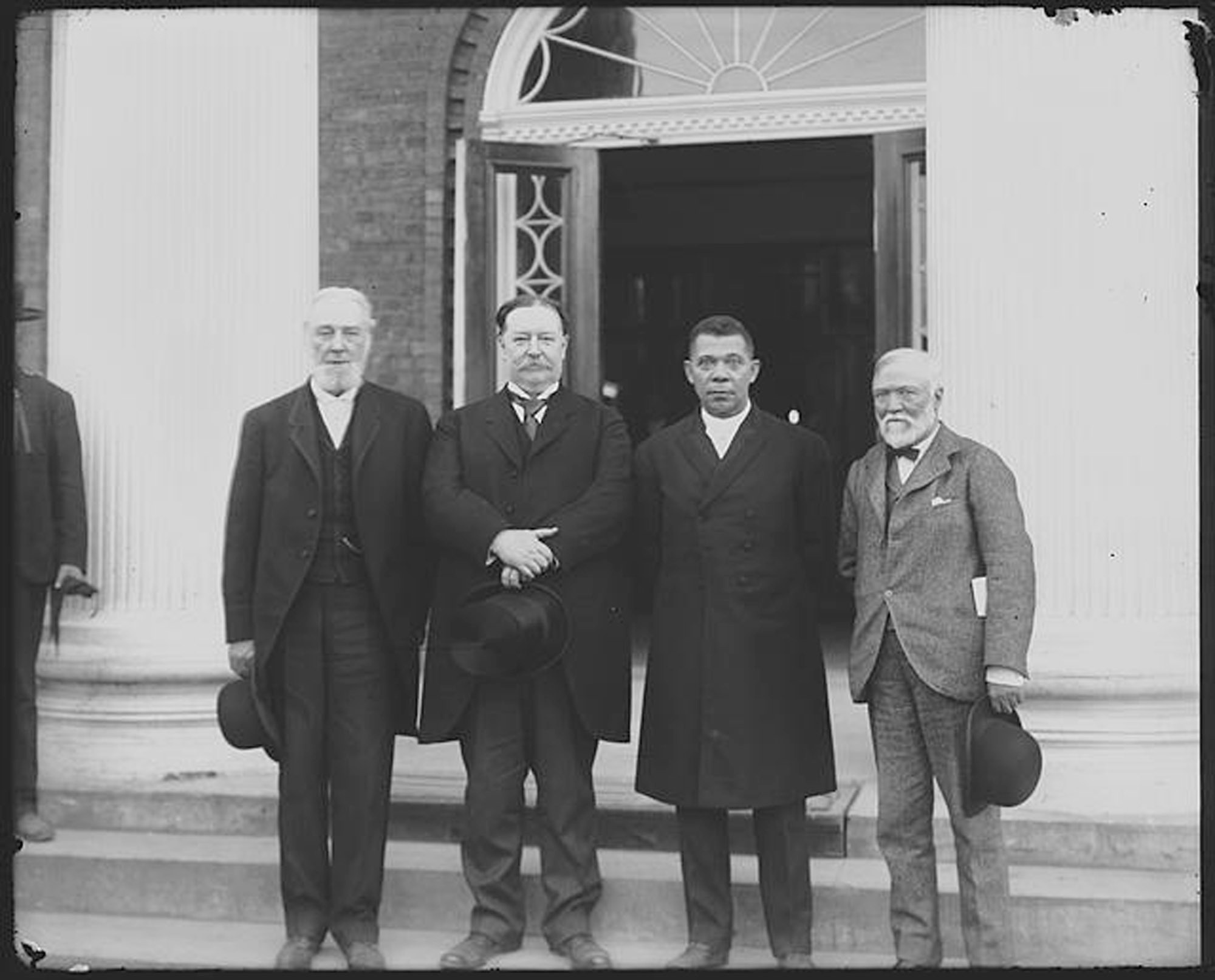 Frances Benjamin Johnston / Library of Congress via APFrom left, Robert C. Ogden, William Howard Taft, Booker T. Washington and Andrew Carnegie stand on the steps of a building in April 1906 during the 25th anniversary celebration of what is now Tuskegee University in Tuskegee, Alabama. Taft would later become president.