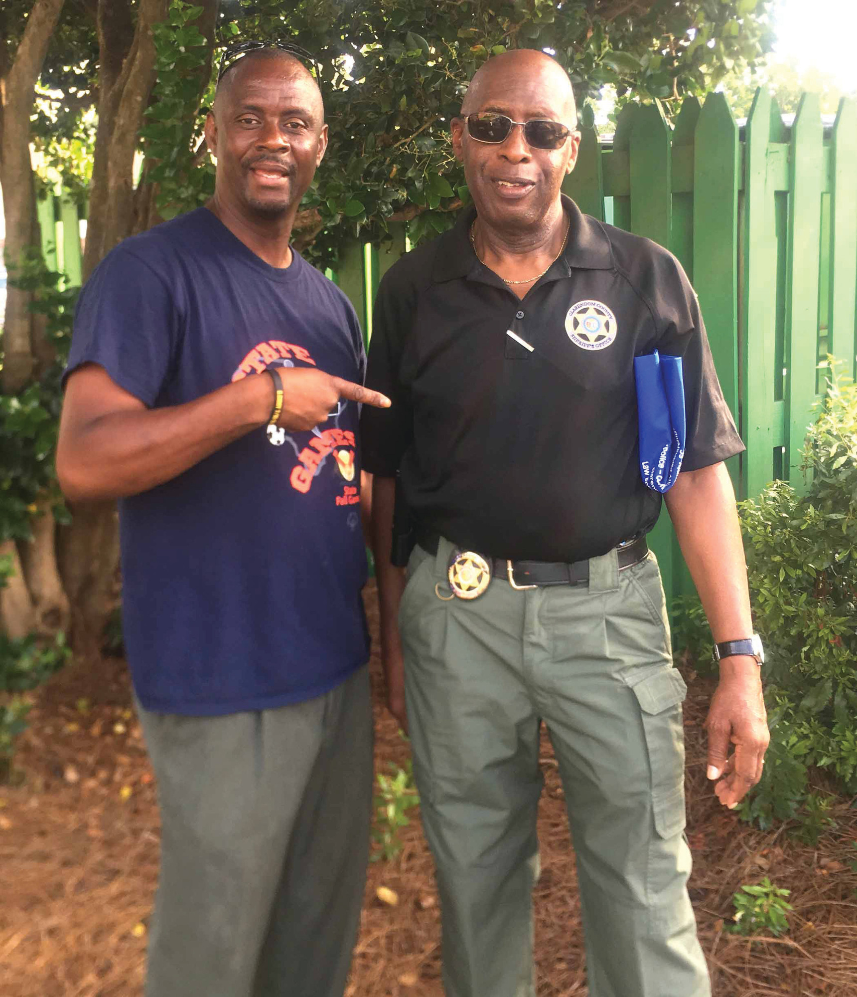 "Deejay Bill ""Soldier Boy"" Lemon points at the chairman of National Night Out in Clarendon County, Lawrence Hammett, who works at Clarendon County Sheriff's Office."