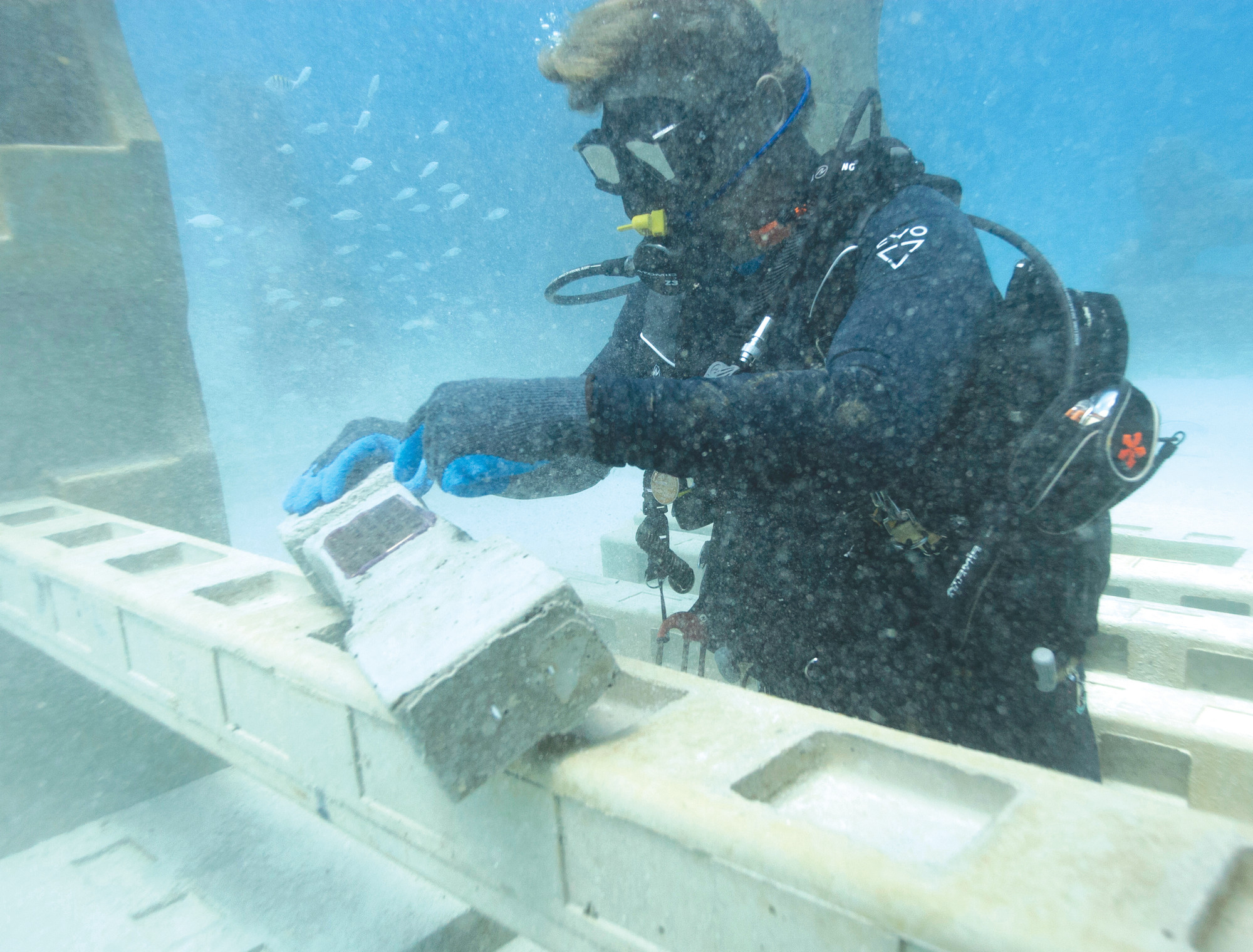 Jim Hutslar, operations director for Neptune Memorial Reef, prepares to install a memorial plaque for Buel and Linda Payne, affixed to a cement baluster mixed with their ashes, at the Neptune Memorial Reef near Miami Beach. The cemetery is already home to the cremated remains of about 1,500 people and is welcoming thousands more seeking life in the afterlife.