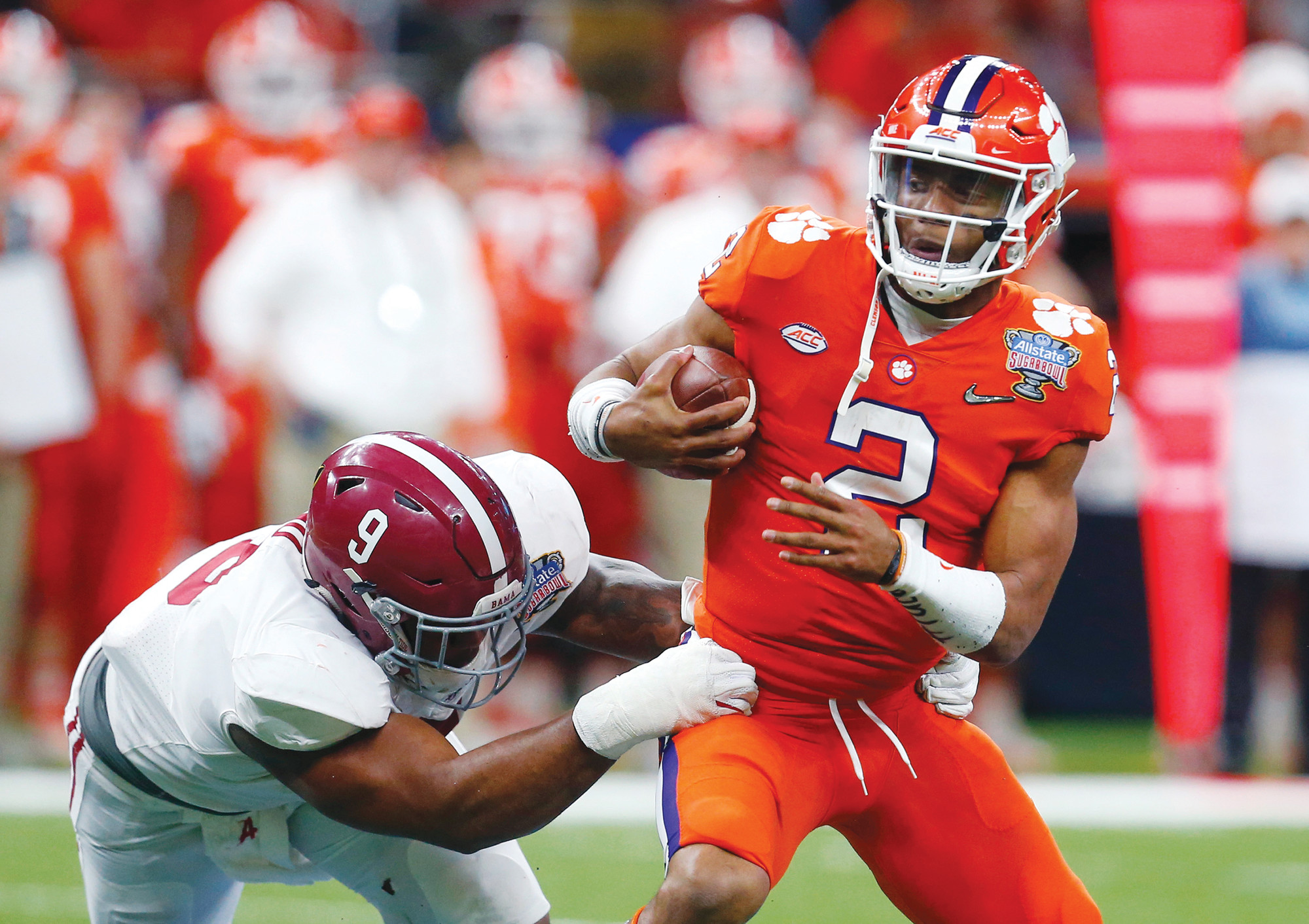 Clemson quarterback Kelly Bryant (2) led the Tigers to the College Football Playoff last season, but the question is being raised about whether he'll be replaced by freshman Trevor Lawrence.