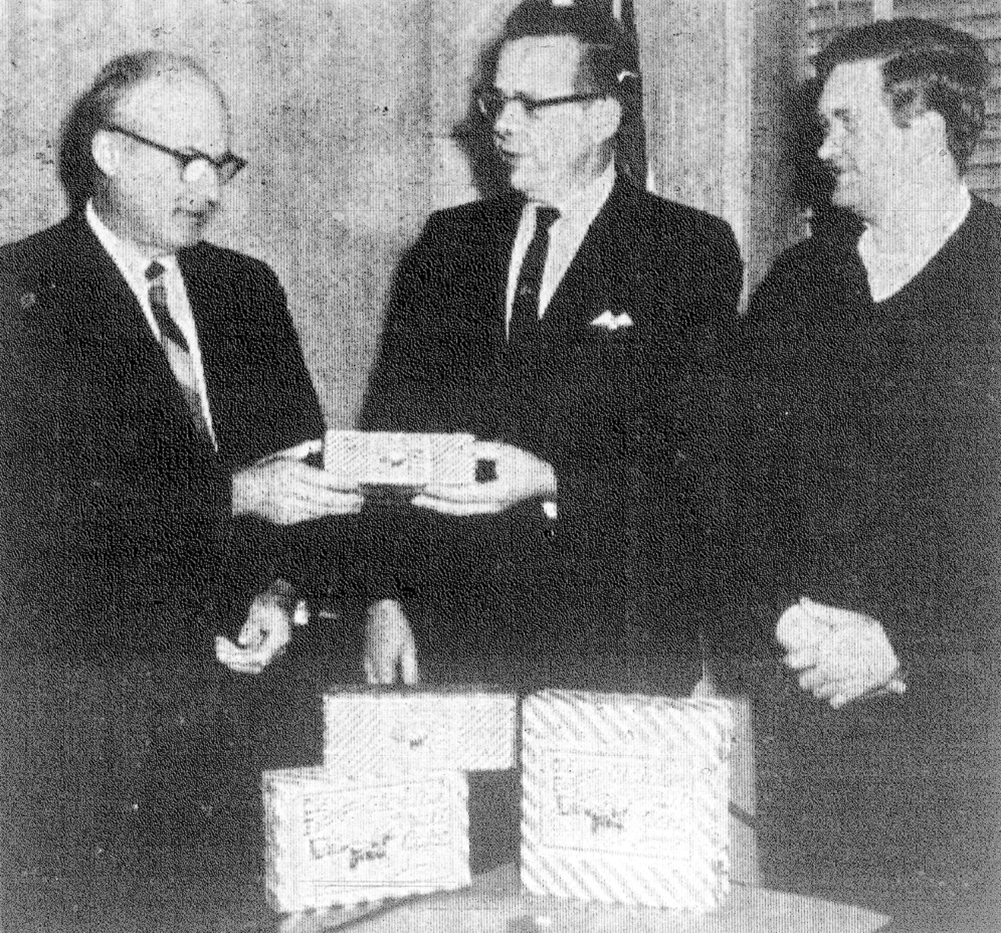 SUMTER ITEM FILE PHOTO  1968 - Mayor Robert E. Graham, left, buys the first fruitcake to kick off the annual Sumter Civitan cake sale. Civitans Don E. Ague, center, and Lester McDaniel make the first sale to him.