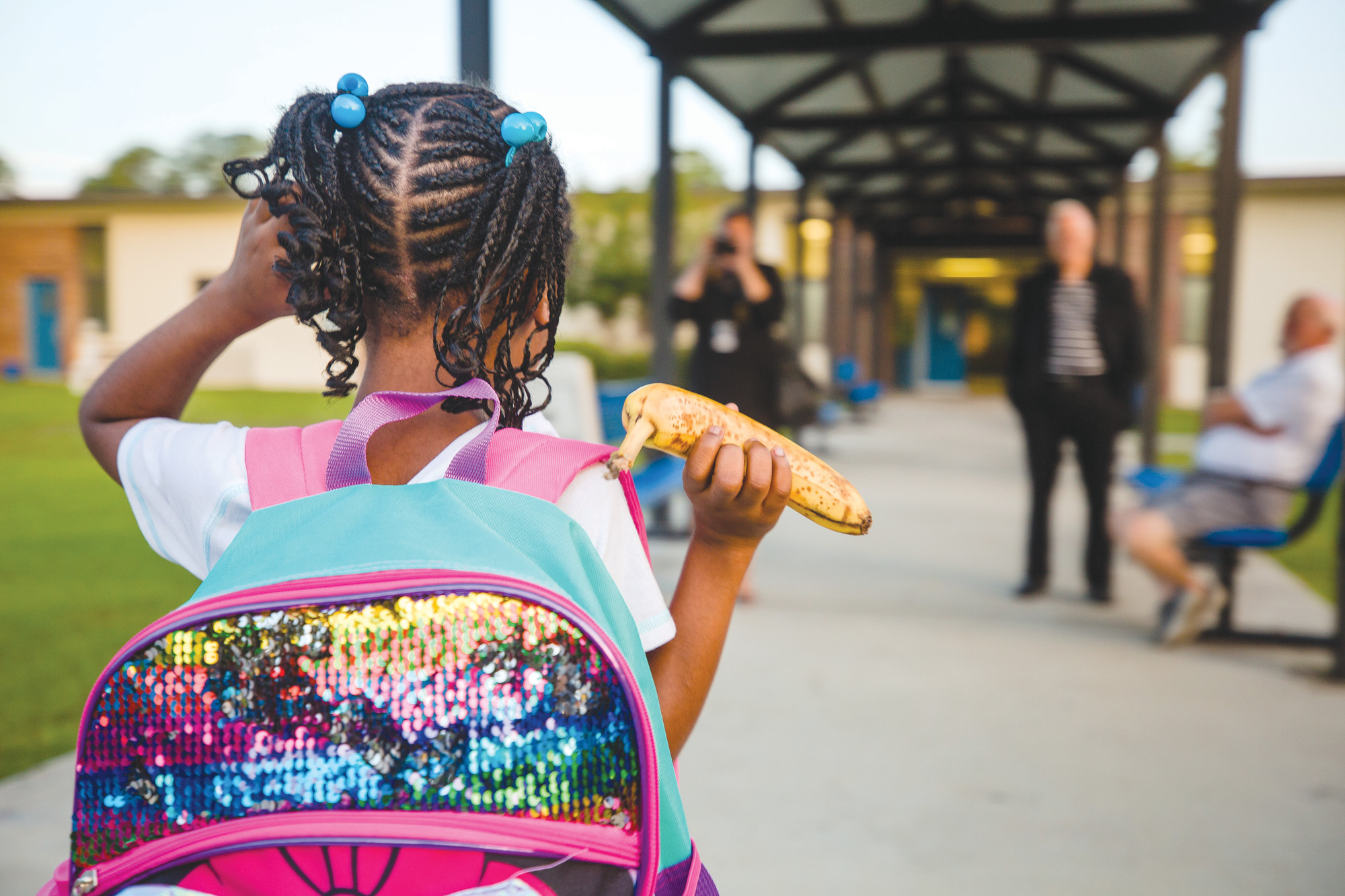 A student at Willow Drive Elementary School walks to her school for the first day on Monday.