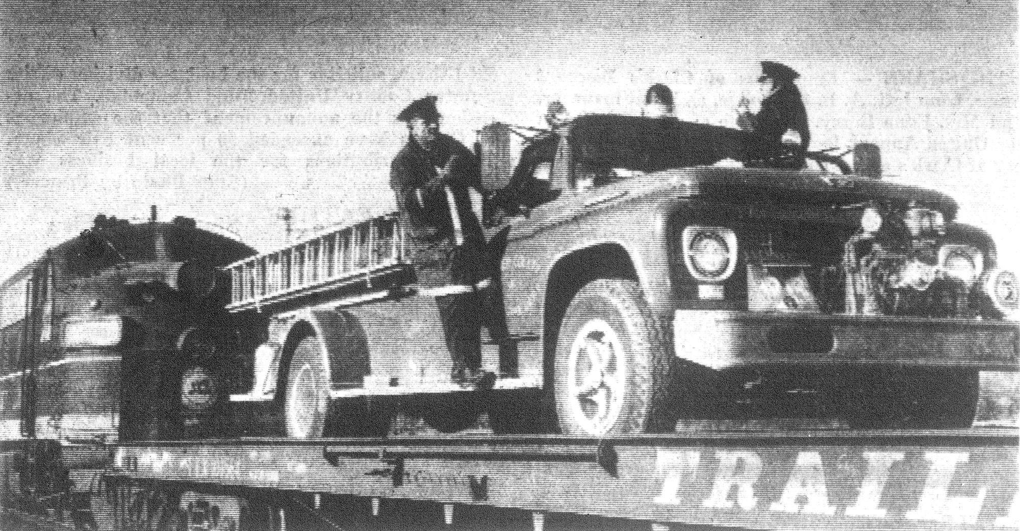 1968 - Sumter Fire Department firemen K. O. Mims, on left side of truck, and T. A. Green were checking radio communications as they prepared to depart early in a unique manner - piggyback style on a flat car - to help battle the Seaboard Coast Line Railroad trestle fire in the Rimini area.