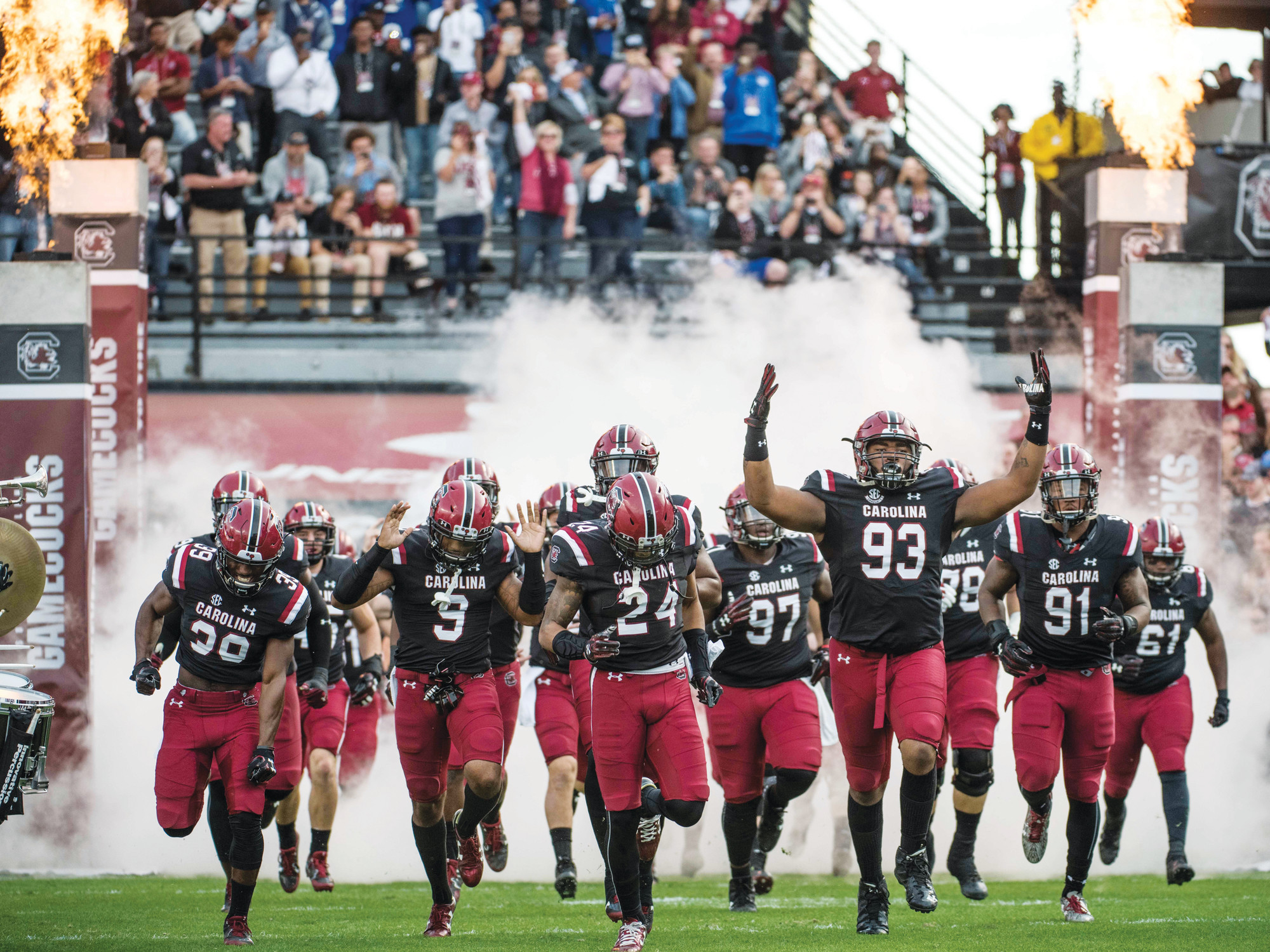 South Carolina defensive lineman Ulric Jones (93) leads the Gamecocks onto the field before their 2017 game against Wofford in Columbia. USC defeated the Terriers 31-10.