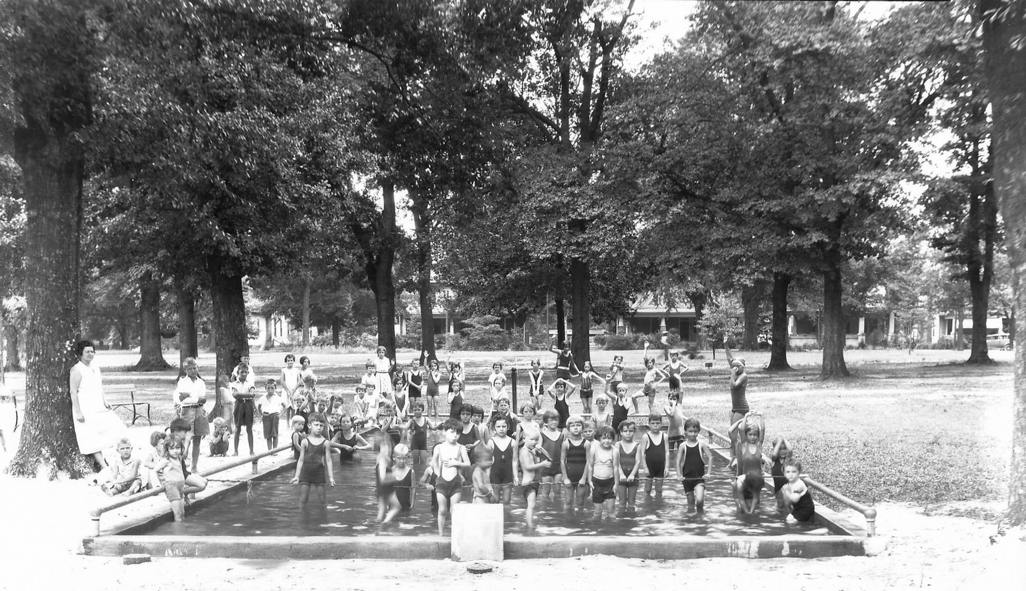 Children play in Memorial Park's wading pool in the 1940s.