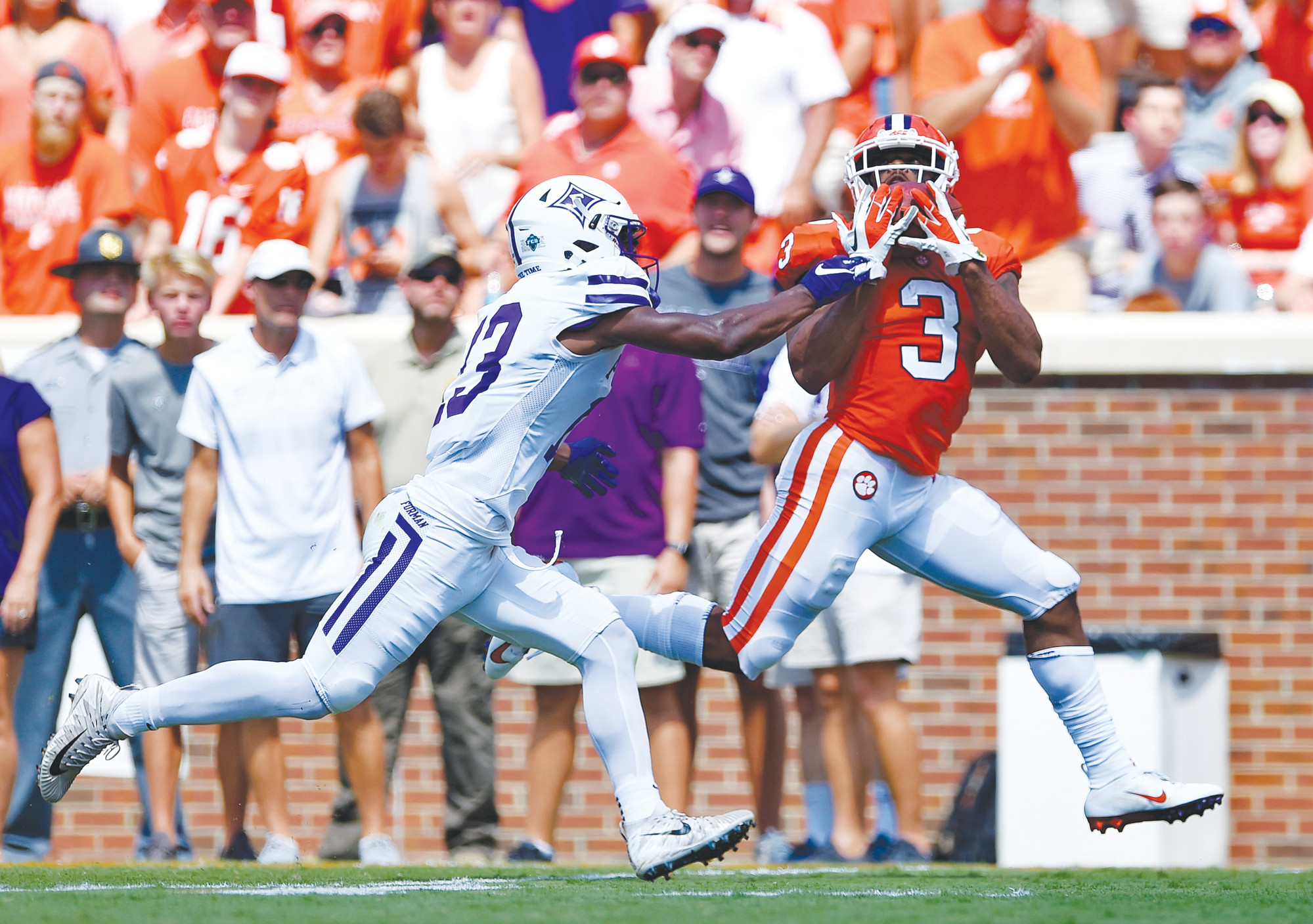 Clemson wide receiver Amari Rodgers (3) pulls in a reception for a touchdown while defended by Furman's Quandarius Weems during the Tigers' 48-7 victory on Saturday in Clemson.