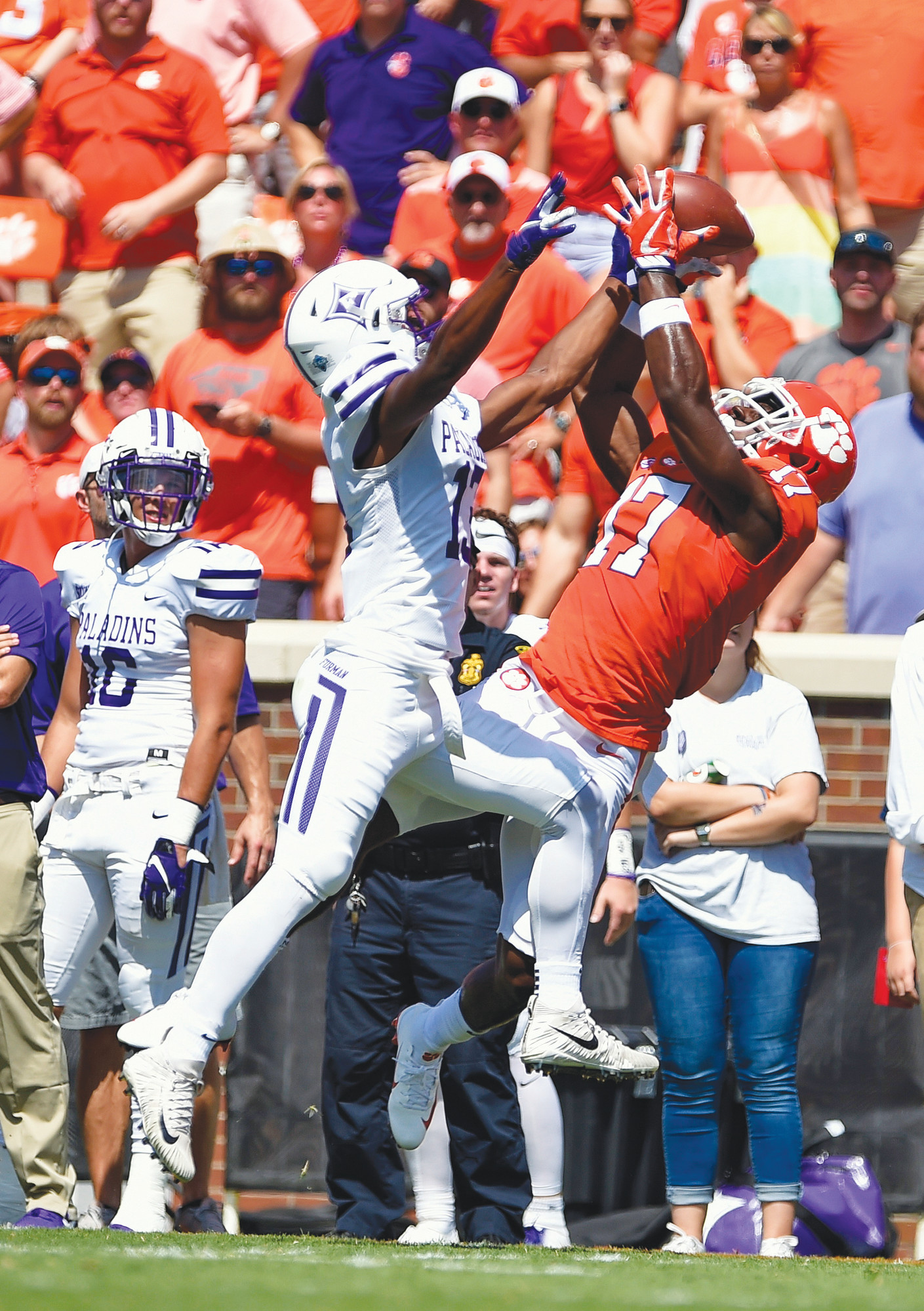 Clemson's Cornell Powell (17) pulls in a reception while defended by Furman's Quandarius Weems during the first half of an NCAA college football game Saturday, Sept. 1, 2018, in Clemson, S.C. (AP Photo/Richard Shiro)