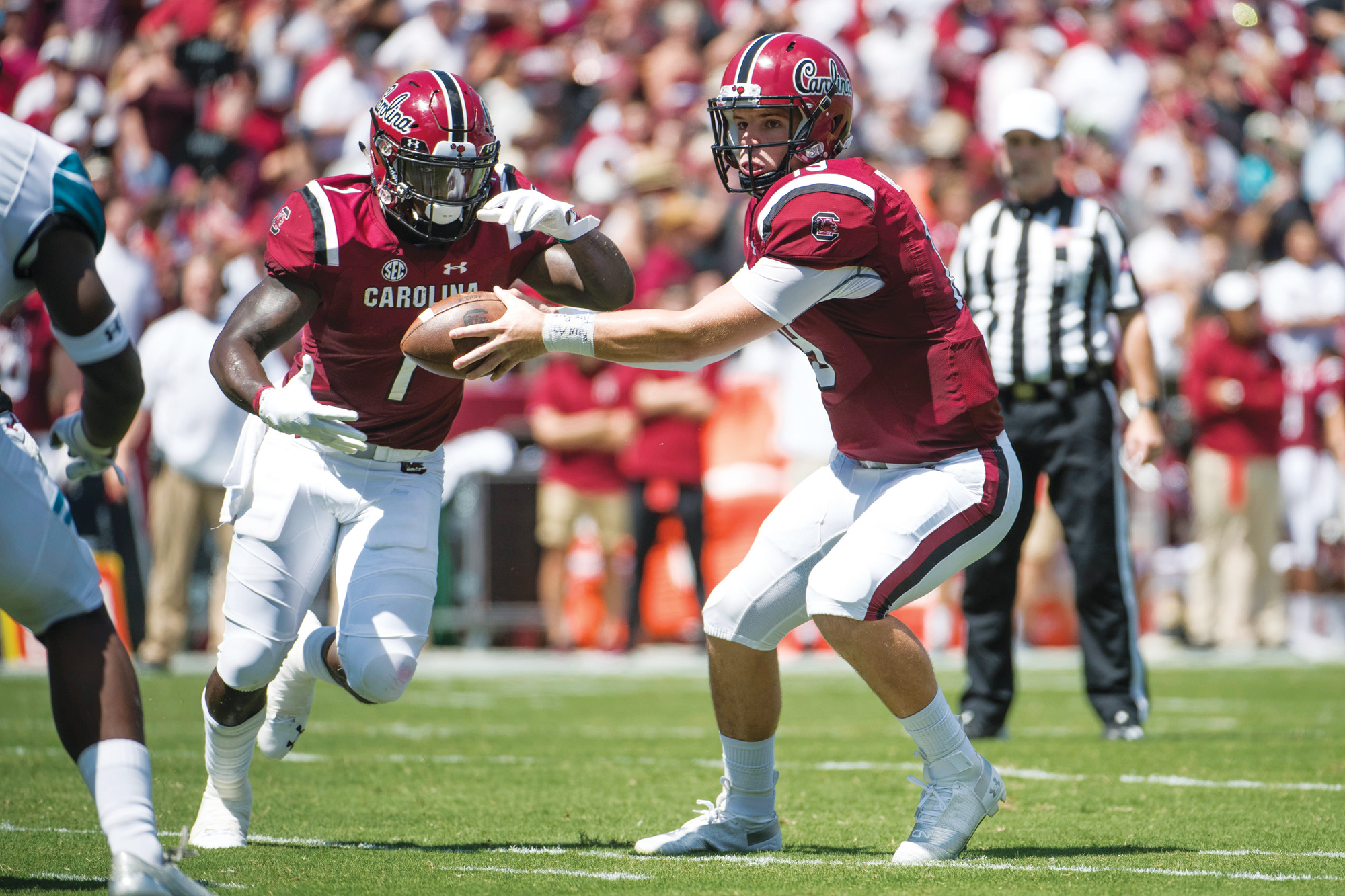 South Carolina quarterback Jake Bentley (19) hands off to wide receiver Deebo Samuel (1) during the first half of the Gamecocks 49-15 victory over Coastal Carolina on Saturday in Columbia.