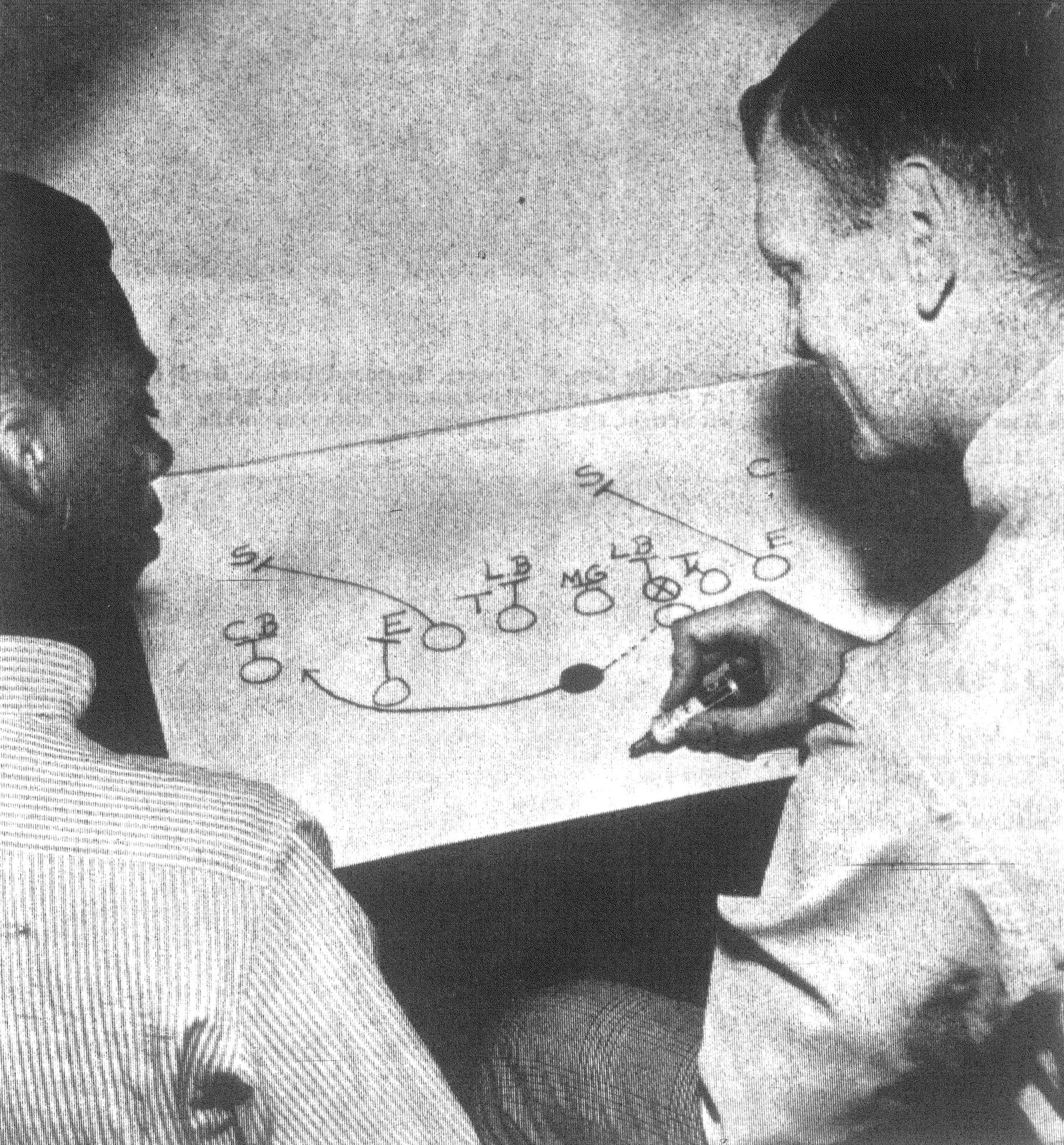 1968 - C. A. Wilson and Coach Buddy Sharp examine a play Wilson used to roll up many yards. The play utilizes Wilson's speed to the outside.