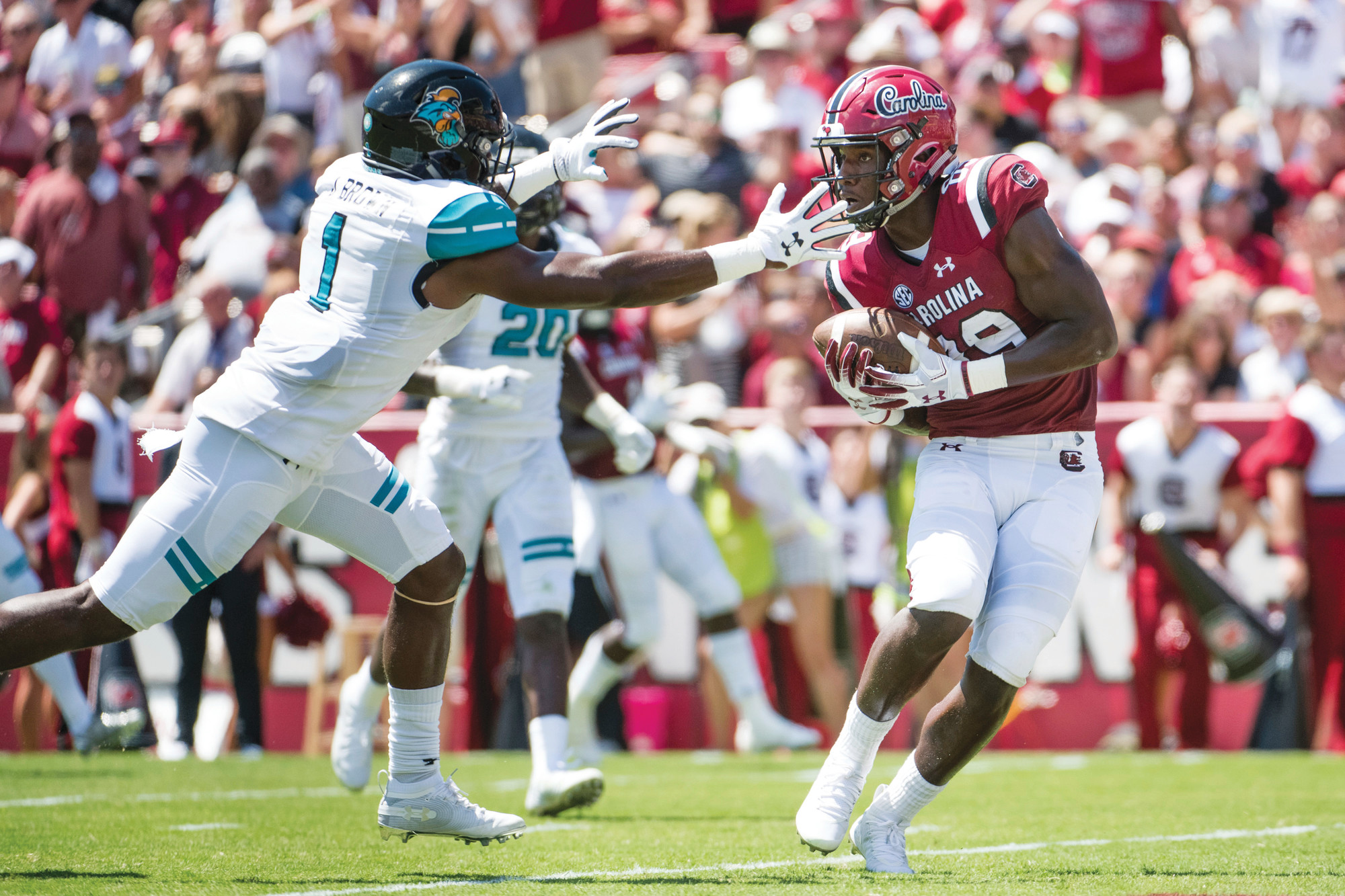 South Carolina wide receiver Bryan Edwards (89) catches a touchdown pass against  Coastal Carolina safety Jave Brown (1) during the first half of the Gamecocks 49-15 victory on Saturday in their season opener in Columbia. USC moved into The Associated Press Top 25 poll at No. 24 entering Saturday's game against No. 3 Georgia.