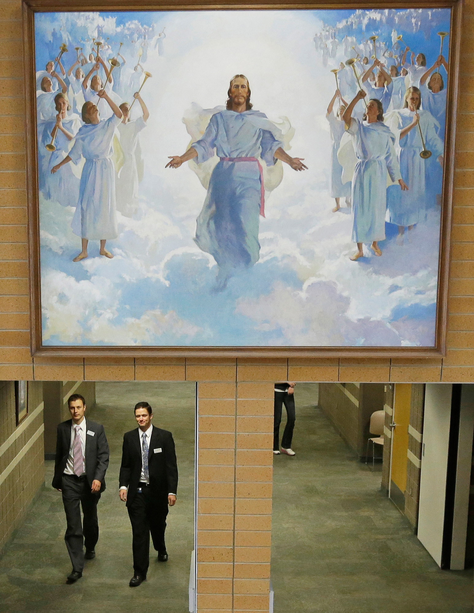 AP FILE PHOTOPeople walk through the halls at the Missionary Training Center in Provo, Utah. The Mormon church says it will let young members know where they're headed to serve their missions online instead of the traditional letters sent by mail.