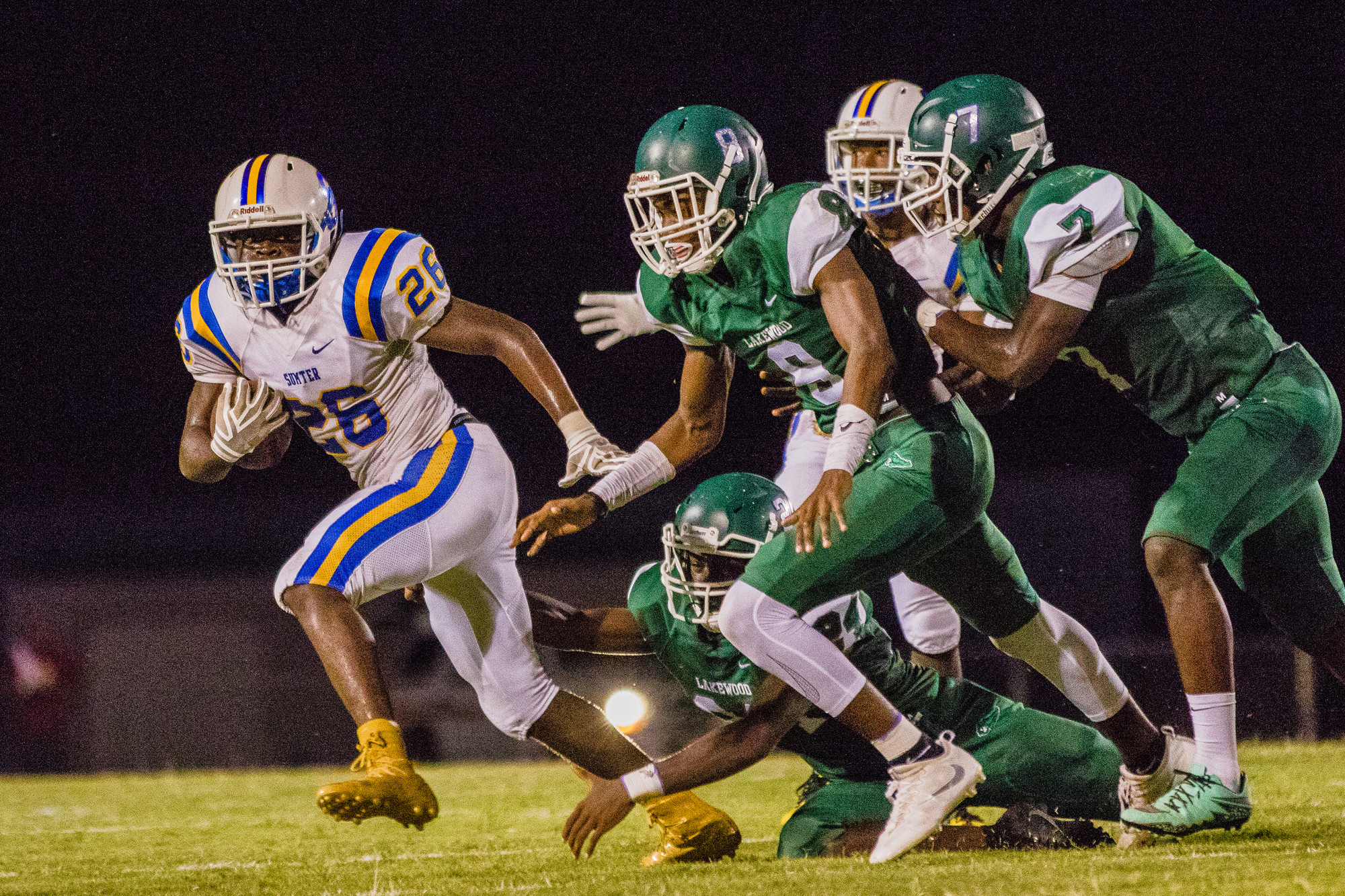 Sumter running back Jonathan Henry evades the Lakewood defense during the Gamecocks' 49-7 victory over their district rivals on Friday at J. Frank Baker Stadium.