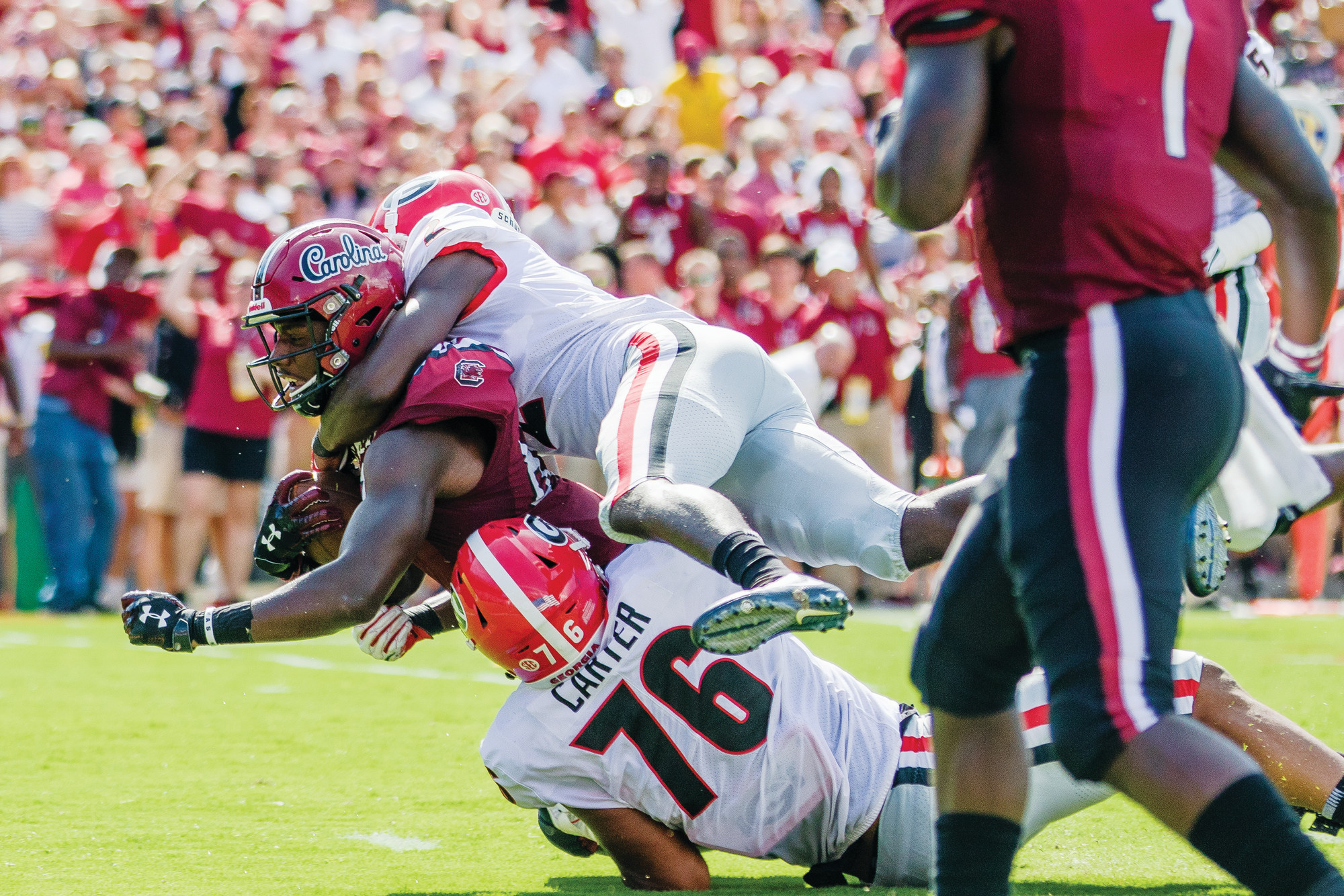 Georgia's D'Andre Swift runs as the Carolina defense pursues during the Bulldogs' 41-17 victory over the Gamecocks on Saturday at Williams-Brice Stadium in Columbia.