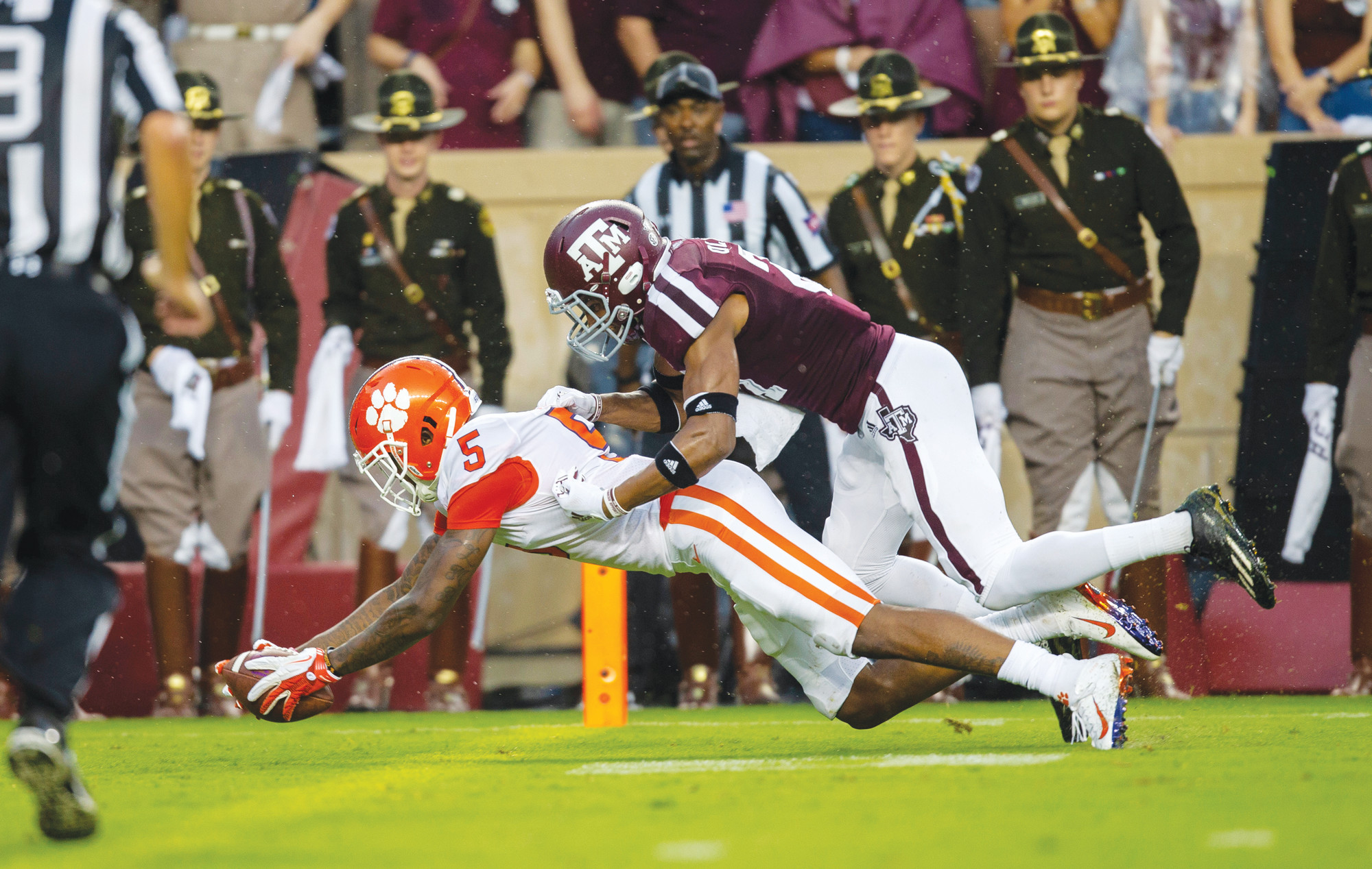 Clemson wide receiver Tee Higgins (5) dives for a touchdown as Texas A&M defensive back Charles Oliver (21) defends during the first half of the Tigers 28-26 victory over the Aggies on Saturday in College Station, Texas.