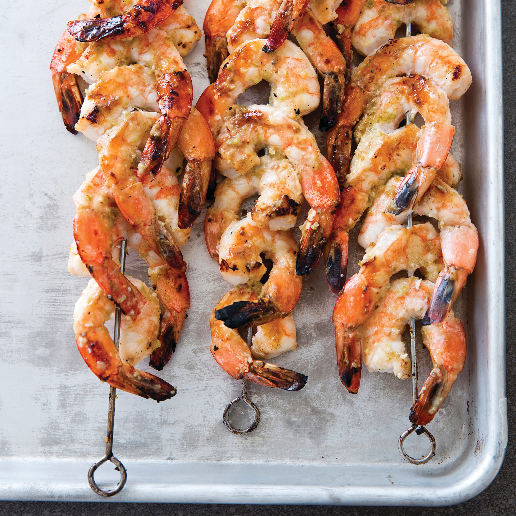 "Grilled jalapeno and lime shrimp skewers are seen in Brookline, Massachusetts. This recipe appears in the cookbook ""Master of the Grill."""