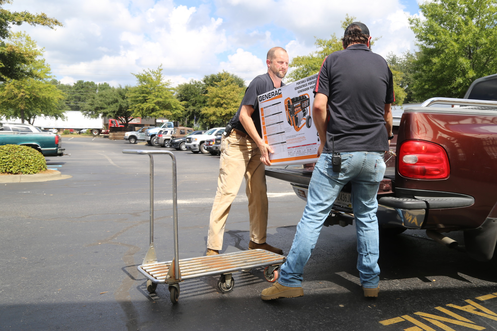 Simpson Hardware employees Chip Humphries, left, and Derek Owen load a generator onto a customer's truck Tuesday afternoon.