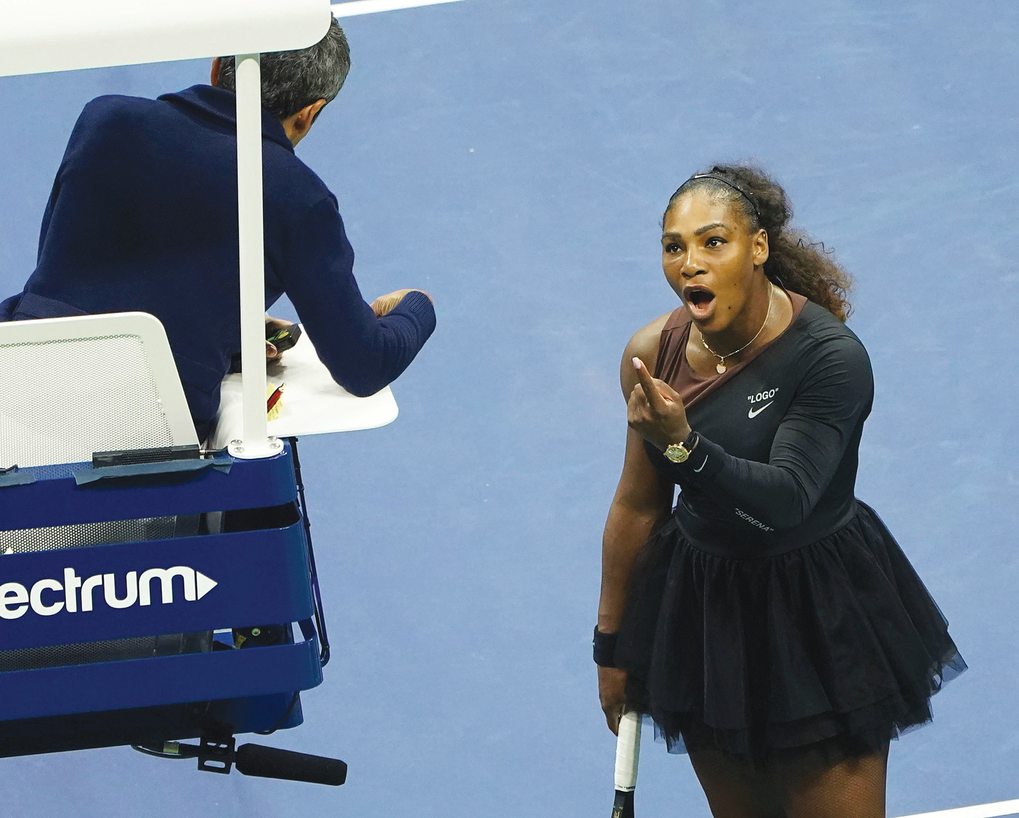 Serena Williams argues with the chair umpire during the women's finals of the U.S. Open on Saturday. Williams was fined for three violations.