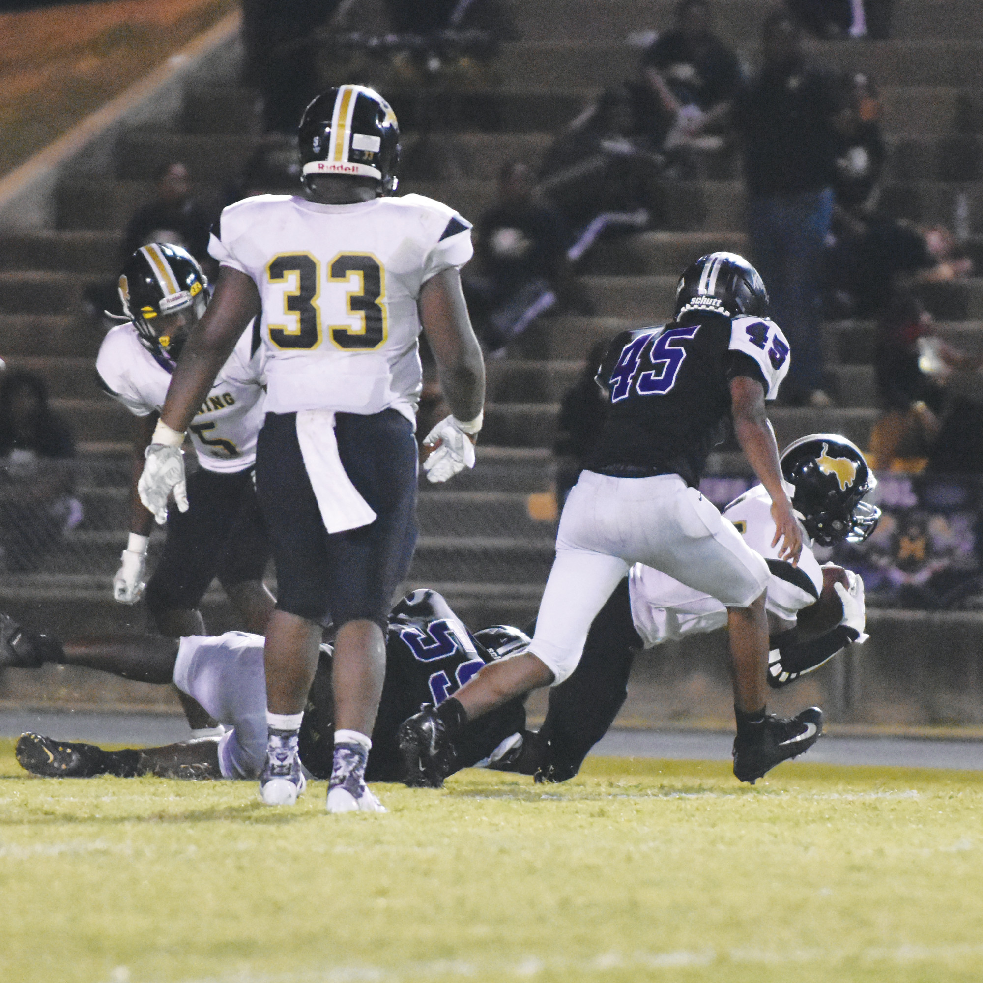 Crestwood defensive end Parris Lowery (55) makes a tackle on Manning wide receiver Aaron Smith during the