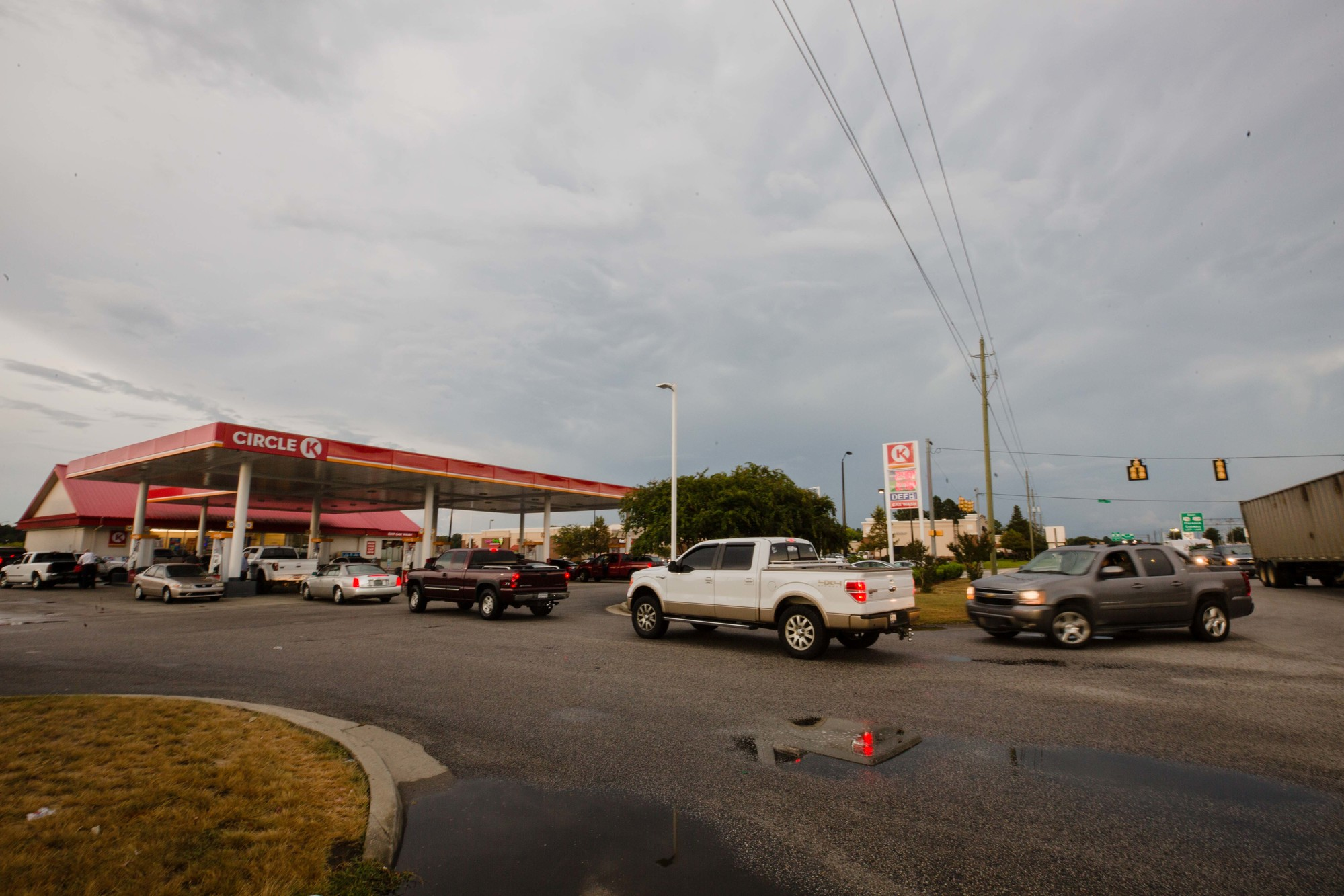 Cars line up at the Circle K near Alice Drive Baptist Church for gas ahead of Hurricane Florence.