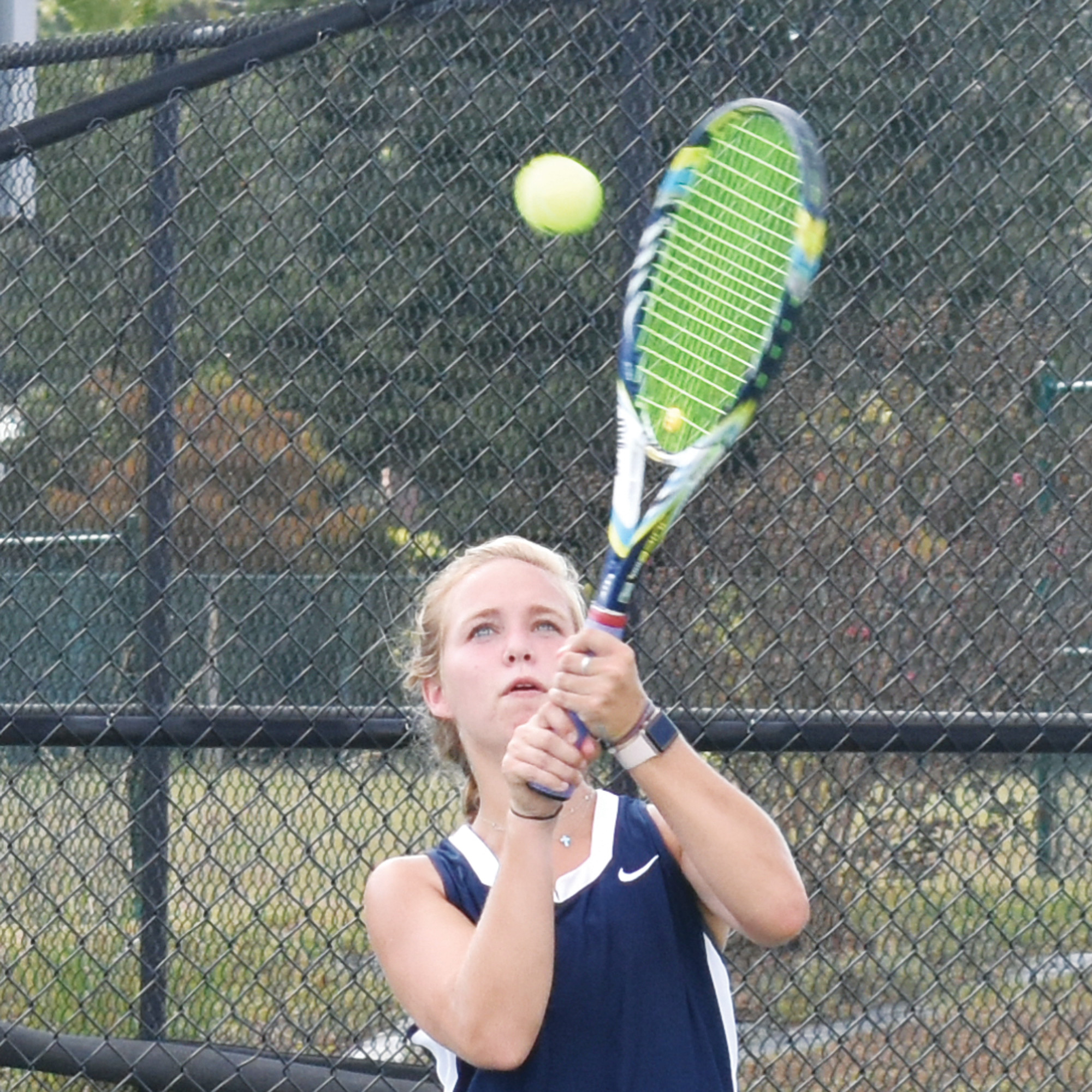 Wilson Hall's Lizzy Davis hits a backhand return during Tuesday's match against Florence Christian.
