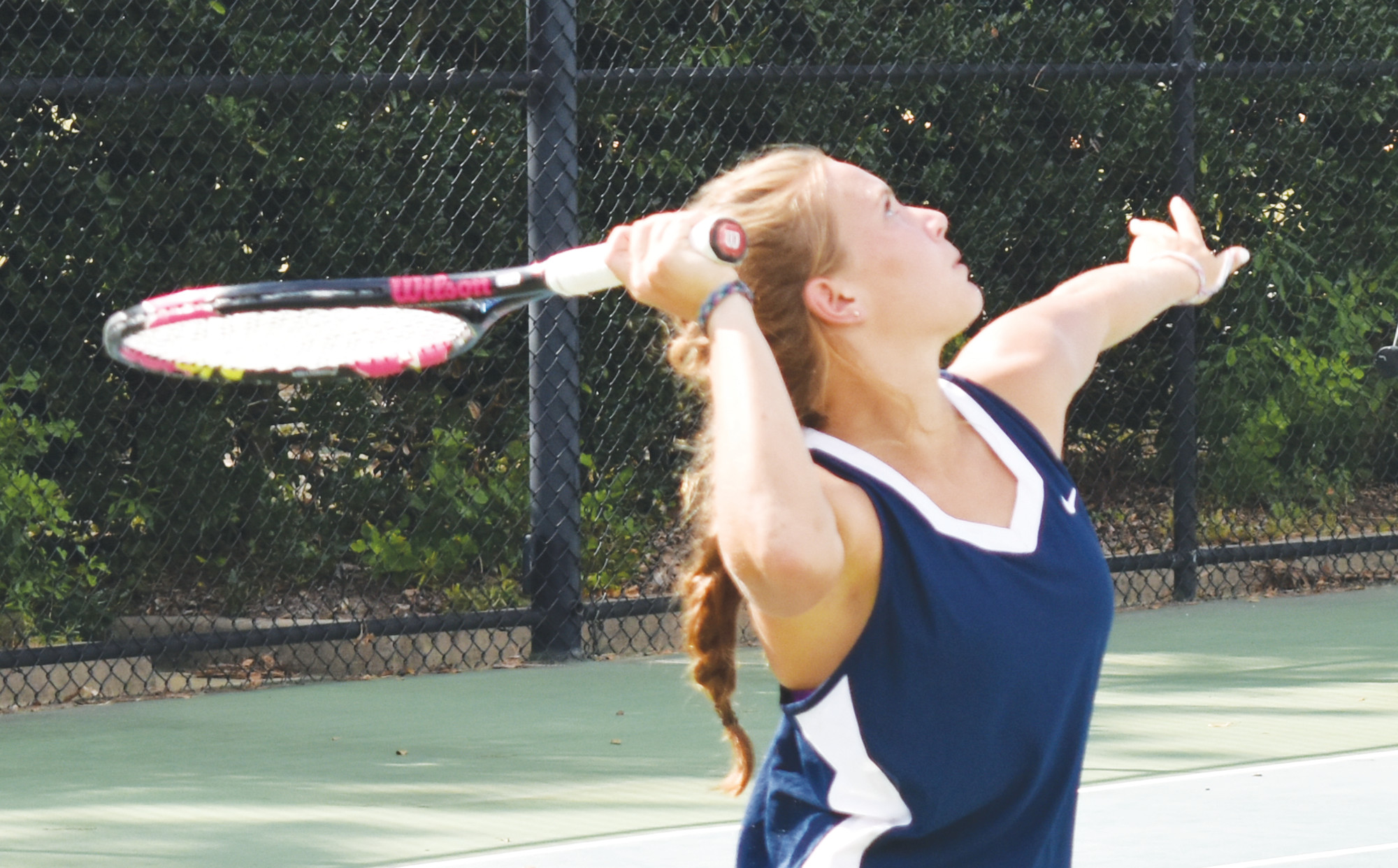 Wilson Hall's Carly Allred eyes a serve during Tuesday's match against Florence Christian at Palmetto Tennis Center.