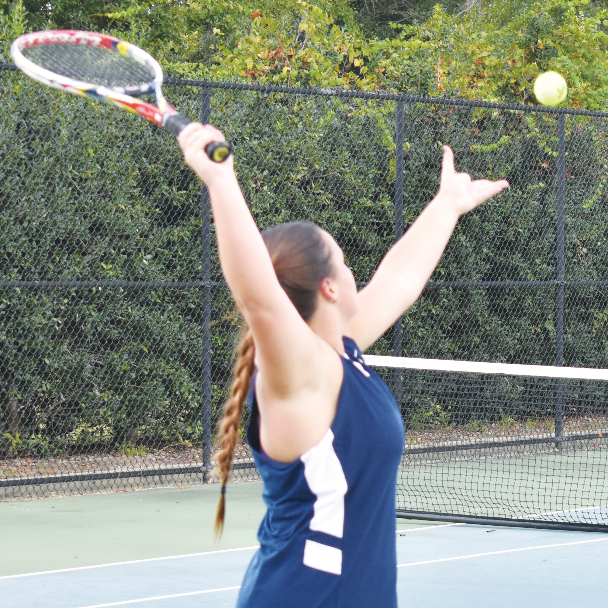 Wilson Hall's Shelby Guldan serves during Tuesday's match against Florence Christian at Palmetto Tennis Center.
