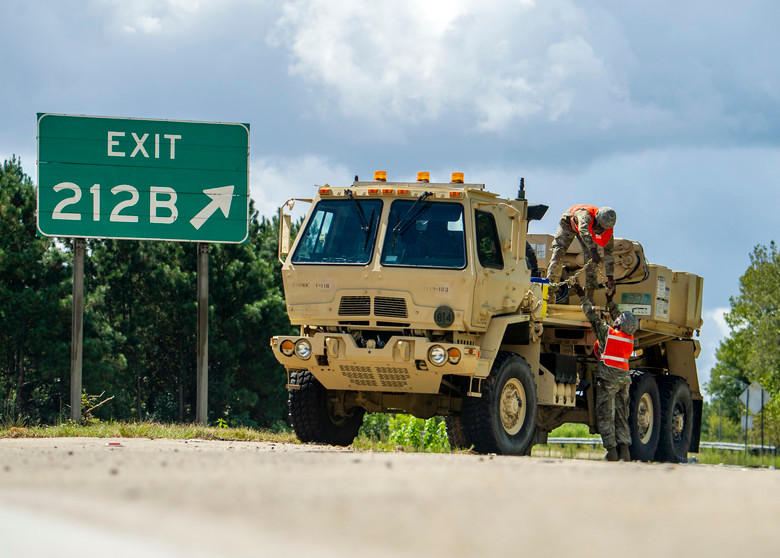 South Carolina Army National Guard soldiers from the 118th Forward Support Company stage recovery equipment to provide support for disabled vehicles during the lane reversal of I-26 in North Charleston on Tuesday.  Approximately 2,000 soldiers and airmen have been mobilized to prepare, respond and participate in recovery efforts.