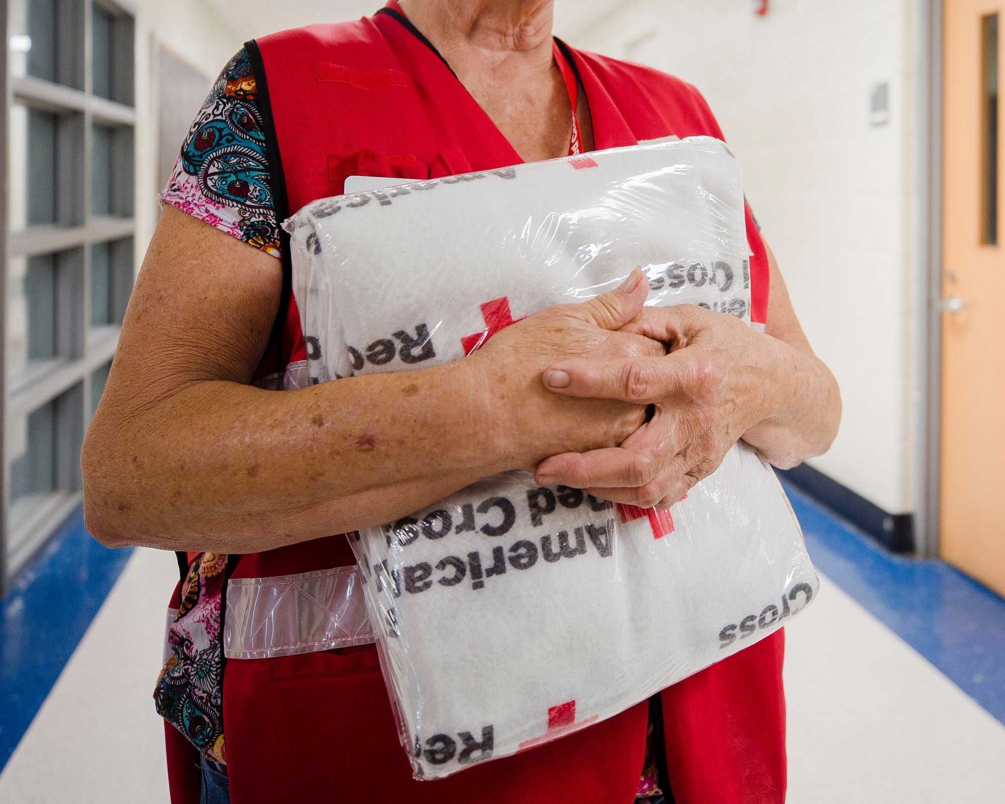 Sue Blackwell holds a Red Cross blanket at Mayewood Middle School on Wednesday.