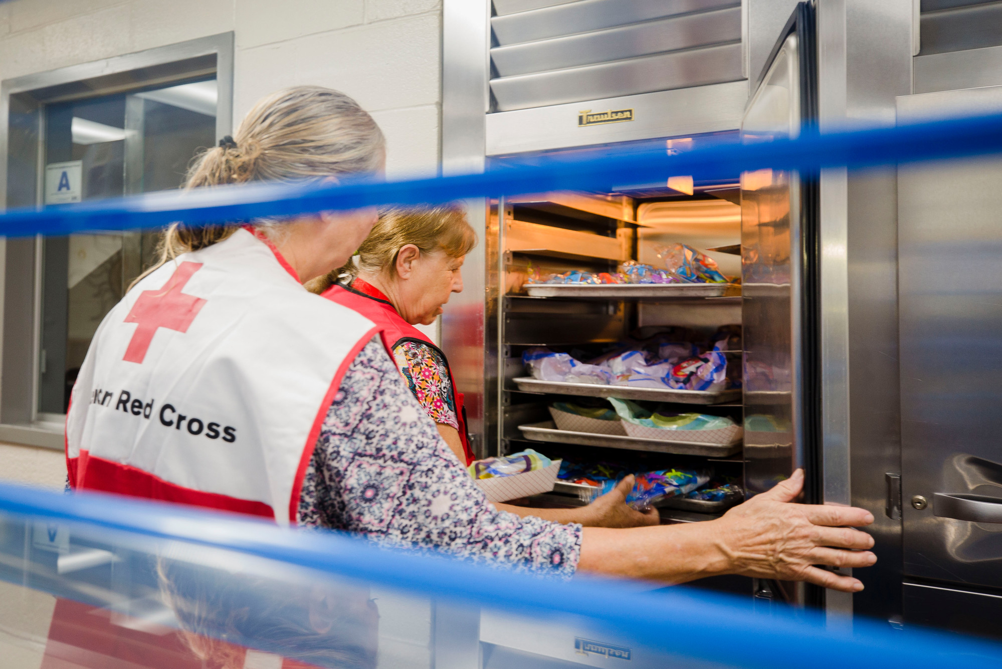 Betty Baun and Sue Blackwell check out the breakfast being stored on Wednesday afternoon at the Red Cross shelter at Mayewood Middle School.