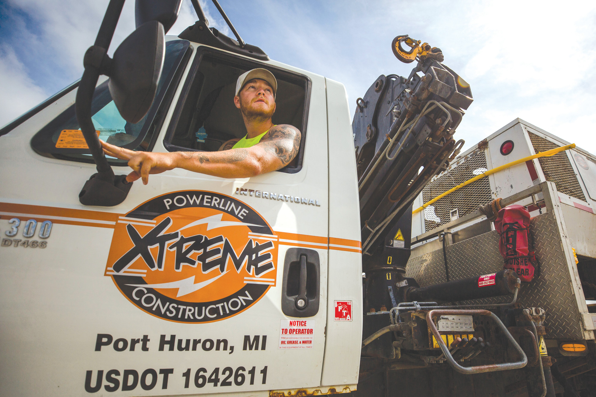 Jake Bieke, an employee with Xtreme Powerline and Construction, speaks with a coworker out of frame. Xtreme Powerline and Construction is out of Port Huron, Michigan, but also has crews in Sumter from Florida, as well.
