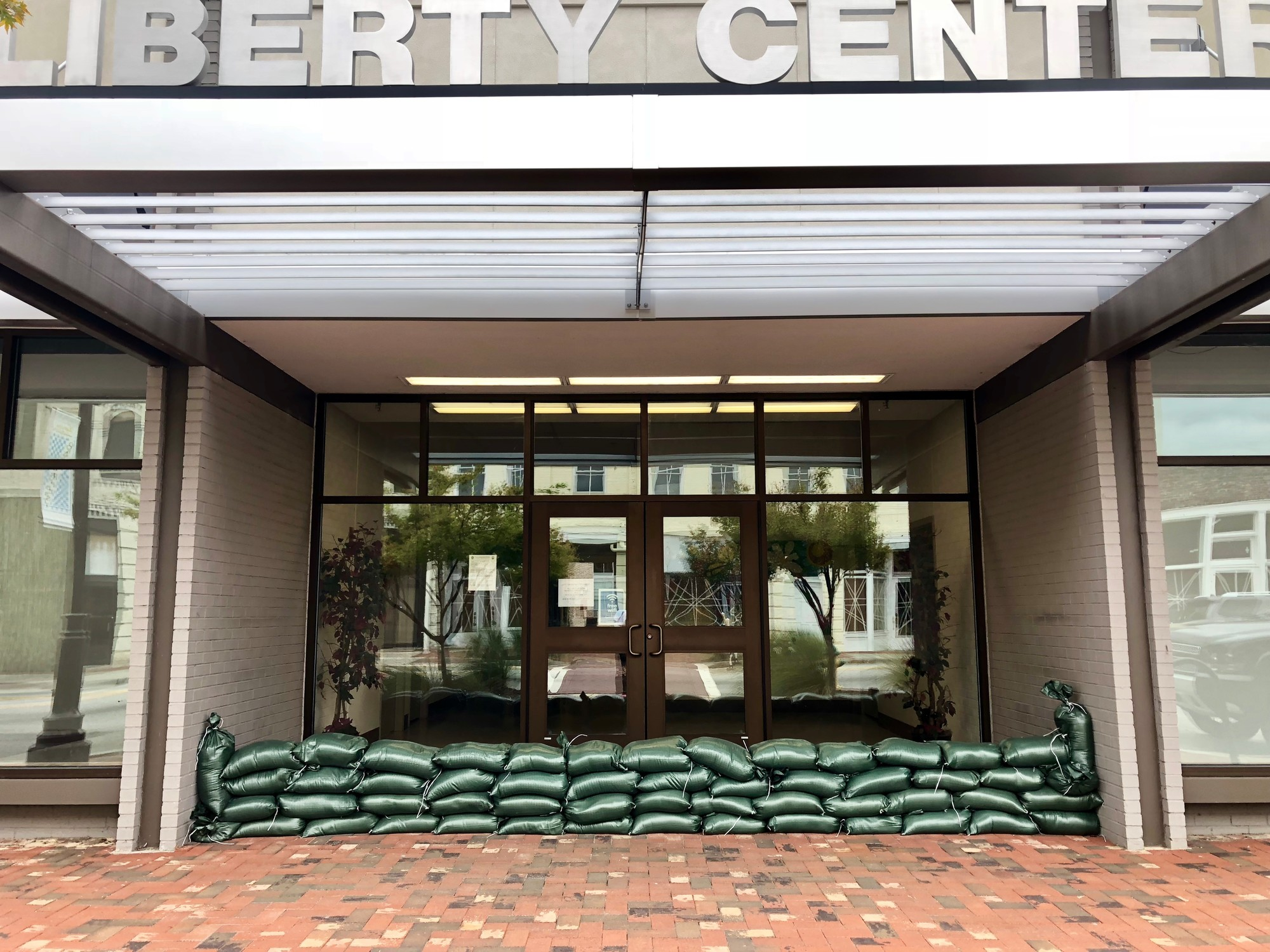 The Liberty Center in downtown Sumter is barricaded by sandbags Friday afternoon.