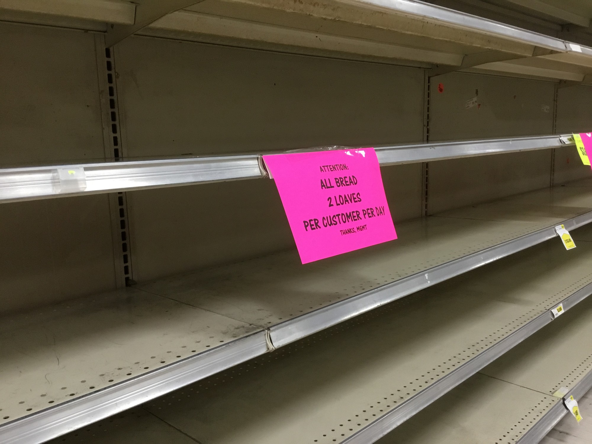 The system to ration bread and water came from the experience of being open for the historic 1,000-year flood in 2015, Piggly Wiggly Store Operator Luther Jamison said. The aisle was empty on Friday, Sept. 14.
