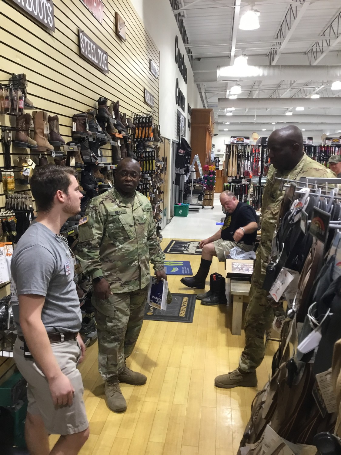 From left, Simpson Hardware employee Trey McLeod talks on Friday afternoon at the store with S.C. National Guard Staff Sgt. Michael King and Lt. Col. Adrian Priester.
