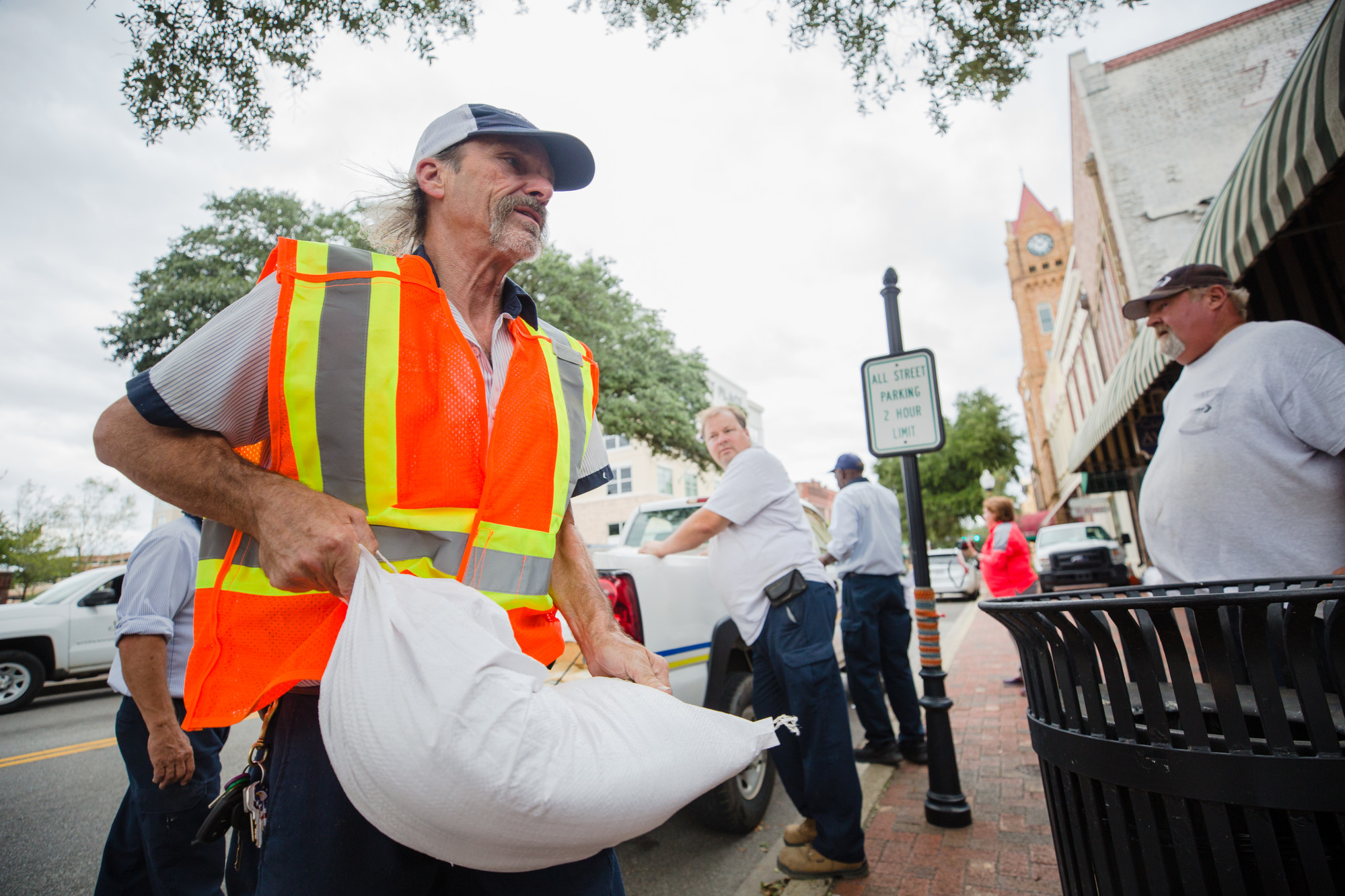 Jeff Bremer helps load sandbags around businesses in downtown Sumter on Friday, Sept. 14 in preparation for Hurricane Florence.