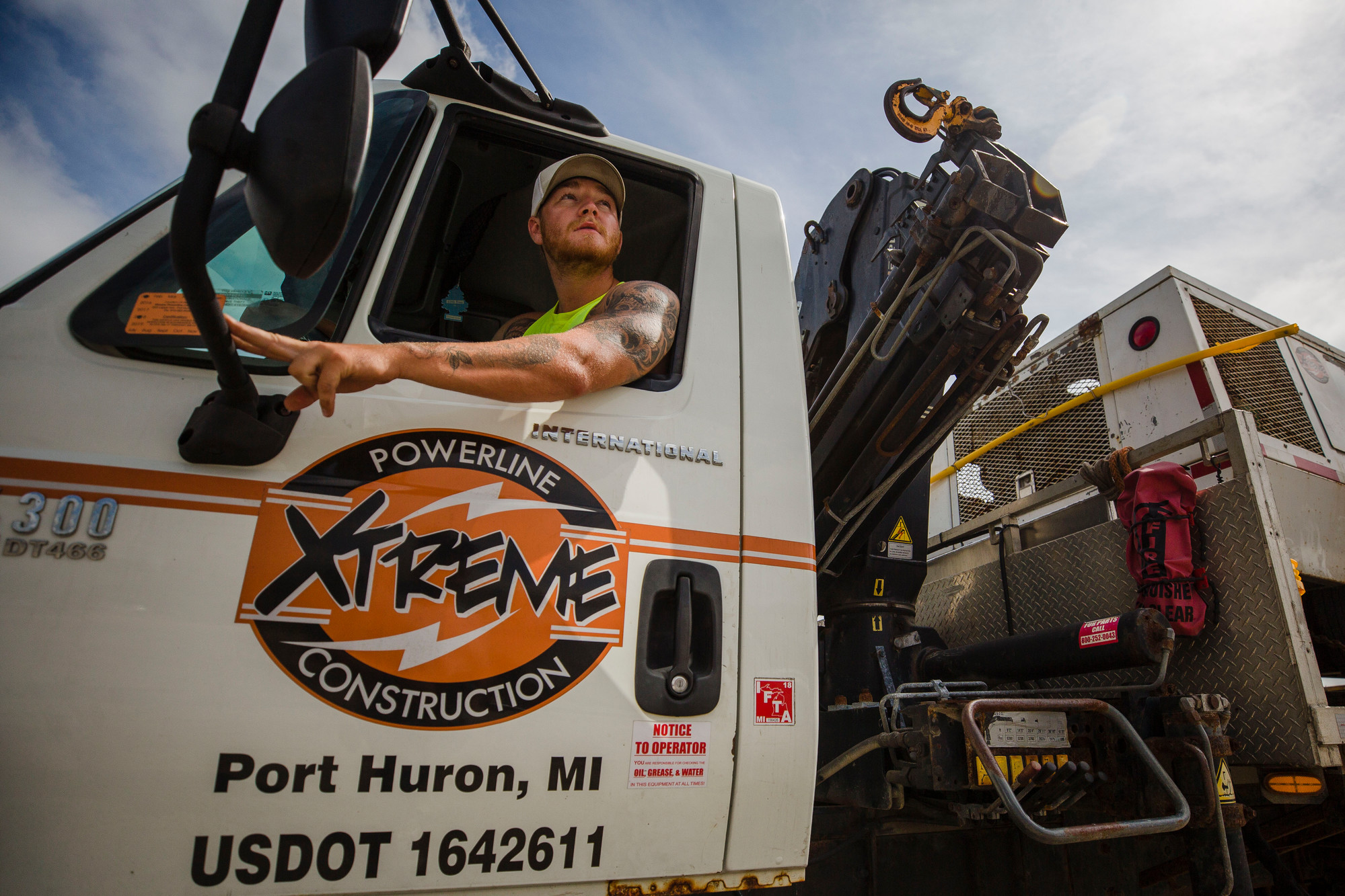 Jake Bieke, an employee with Xtreme Powerline and Construction speaks with a coworker out of frame on Thursday, Sept. 13. Xtreme Powerline and Construction is out of Port Huron, Michigan, but also has crews in Sumter from Florida.