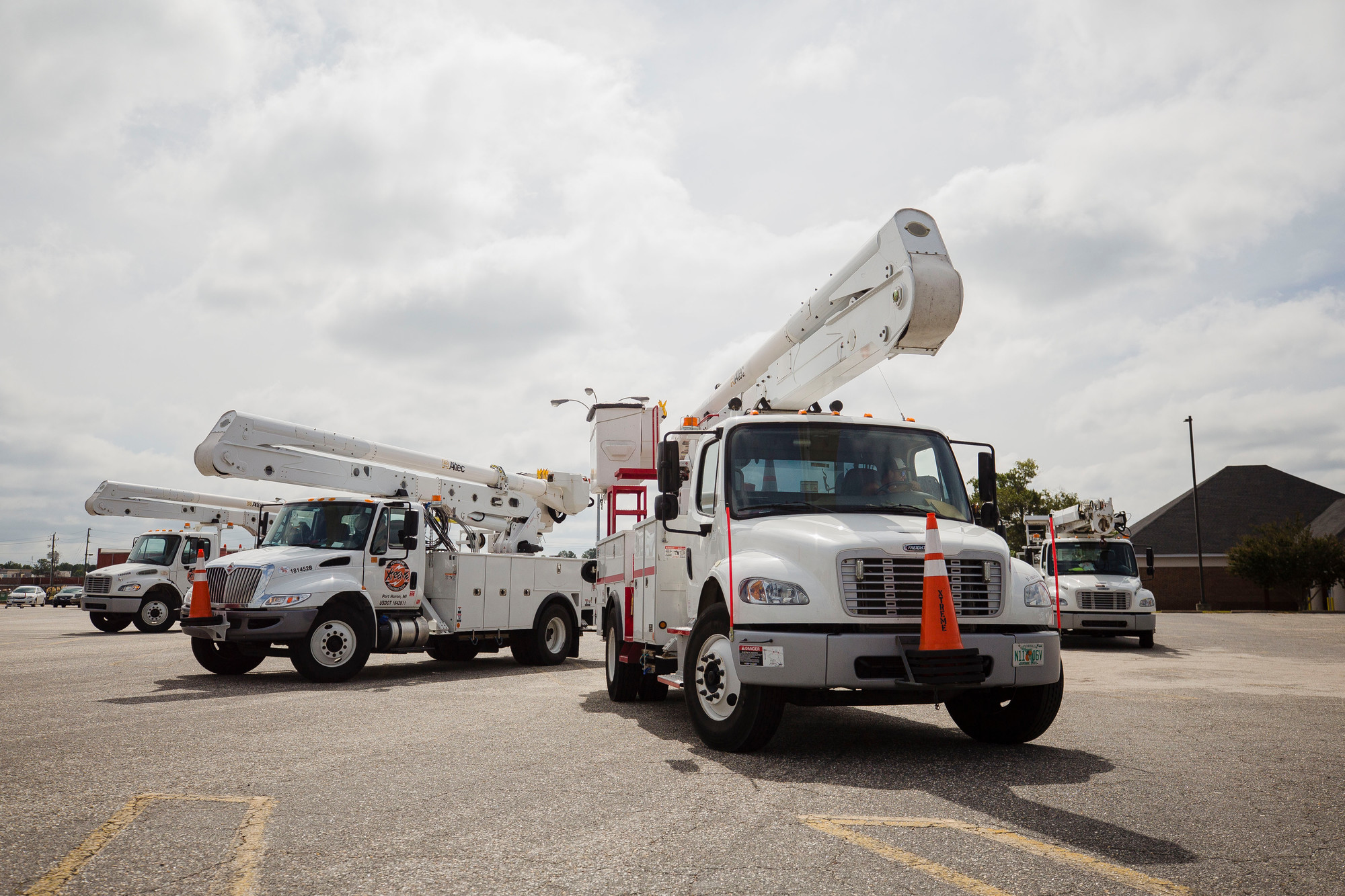 Xtreme Powerline and Construction trucks sit in the parking lot of KMart in Sumter. The company is out of Port Huron, MI, but also has crews in Sumter from its Florida office as well.