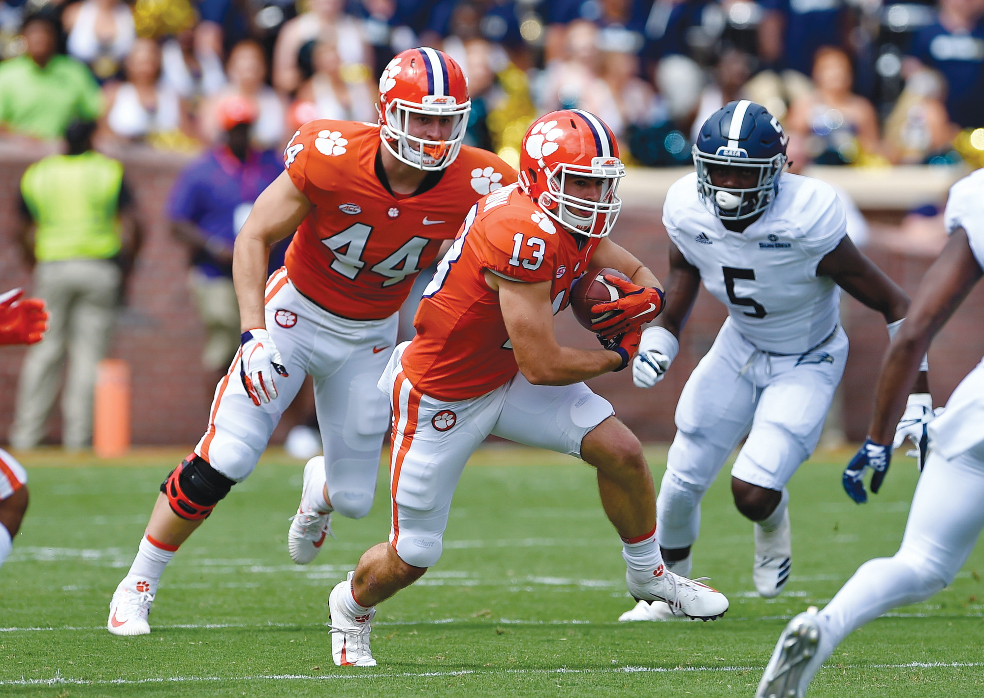 Clemson's Hunter Renfrow (13) avoids the tackle attempt by Georgia Southern's Jay Bowdry (5) with blocking help from Garrett Williams (44) during the first half of an NCAA college football game, Saturday, Sept. 15, 2018, in Clemson, S.C. Clemson won 38-7. (AP Photo/Richard Shiro)