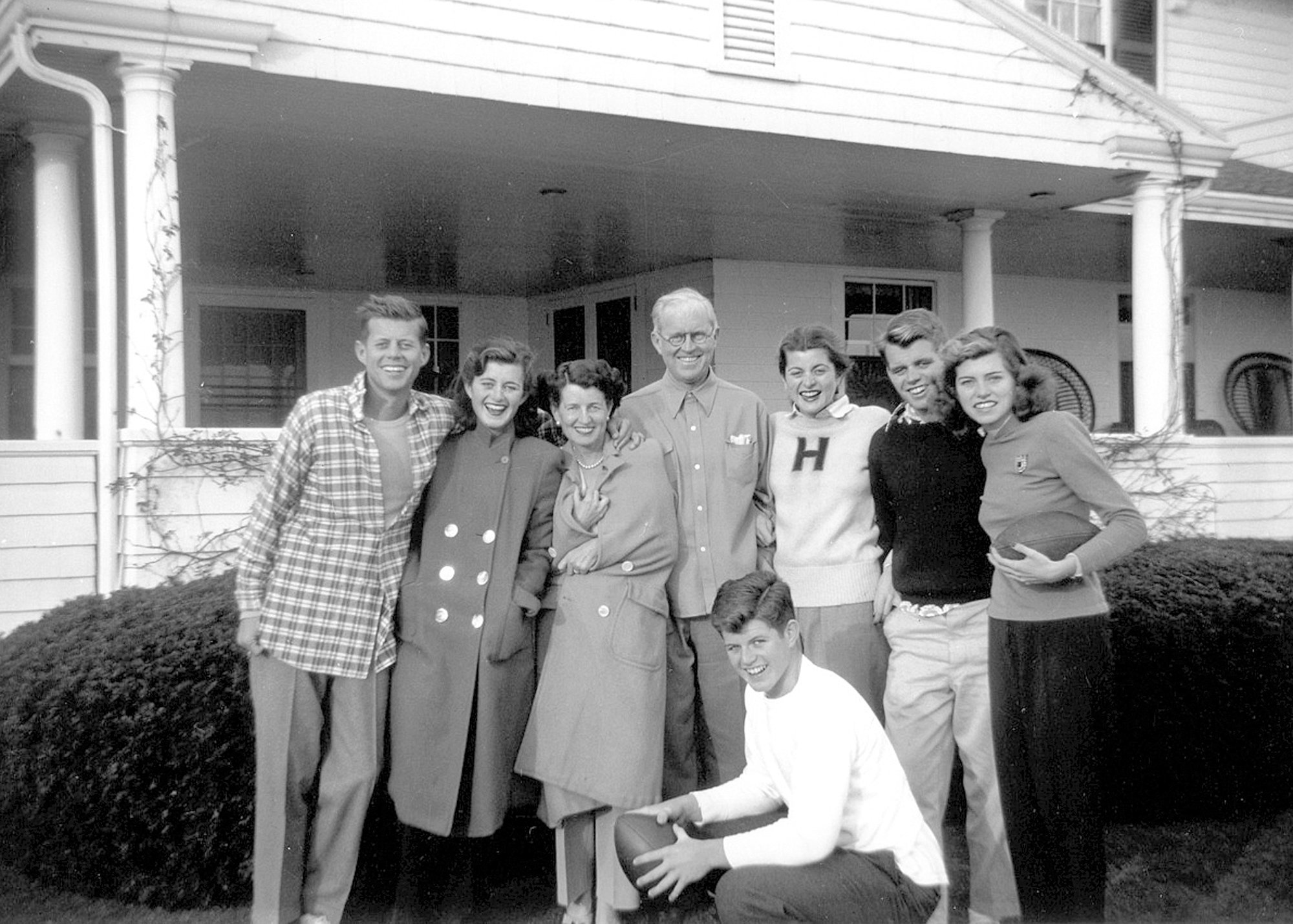 Photos from Kennedy Family Collection  /  John F. Kennedy Library Foundation via APIn this circa 1948 photo provided by the Kennedy Family Collection, courtesy of the John F. Kennedy Library Foundation, members of the Kennedy family pose for a photo in Hyannis Port, Massachusetts. They are from left, John F. Kennedy, Jean Kennedy, Rose Kennedy, Joseph P. Kennedy Sr., Patricia Kennedy, Robert F. Kennedy, Eunice Kennedy, and in foreground, Edward M. Kennedy.