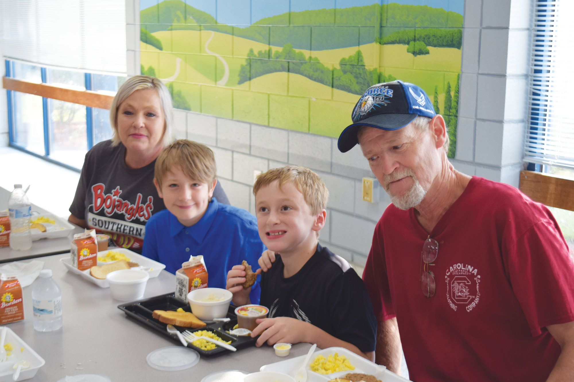 Steve and Kim Meyer eat with grandchildren Ethan Cox and Riley Mosley.