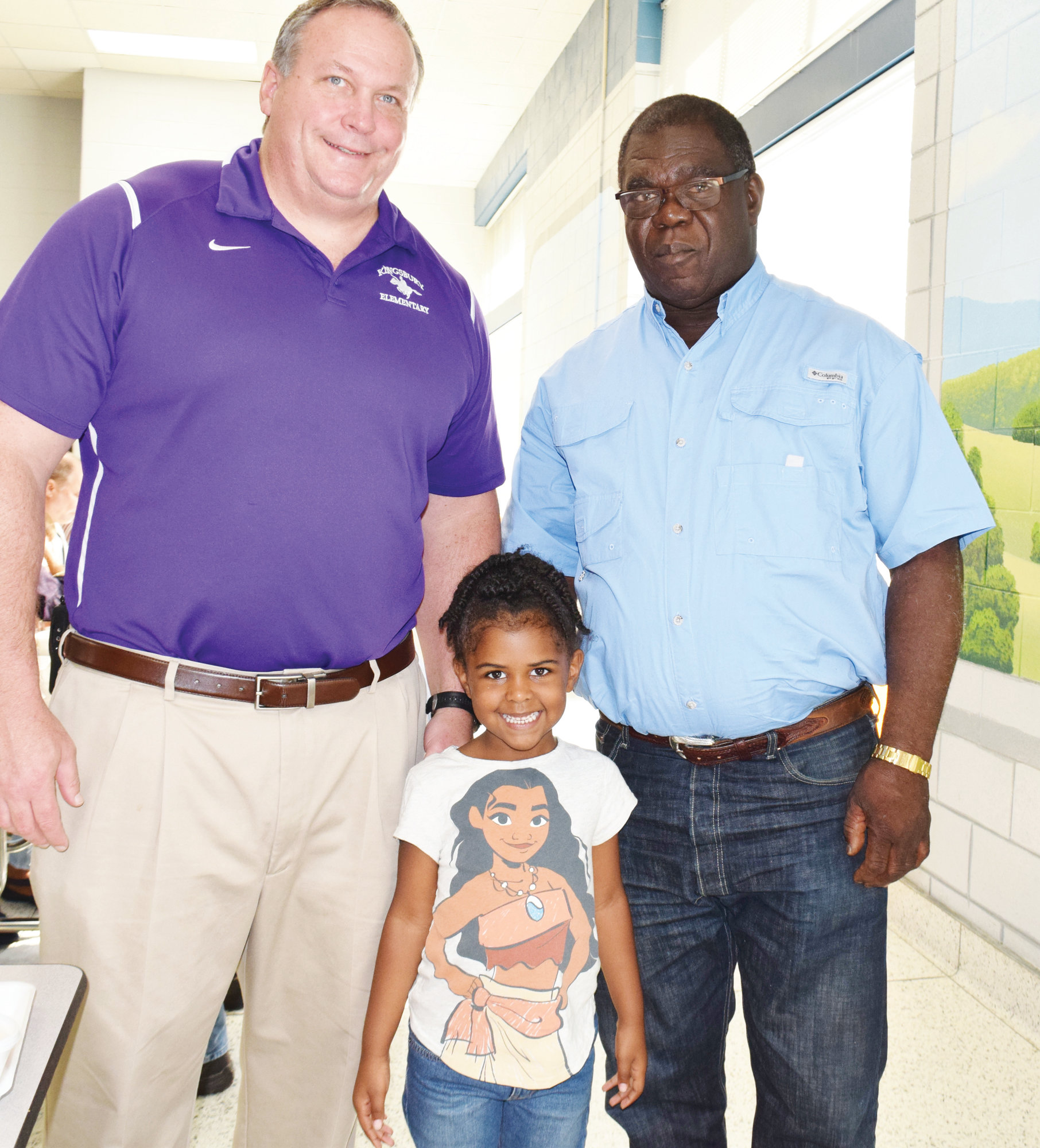 Principal Phillip Jackson meets Hayward Wilson and his granddaughter Melody Wilson, a kindergartner in Mrs. Novak's class.