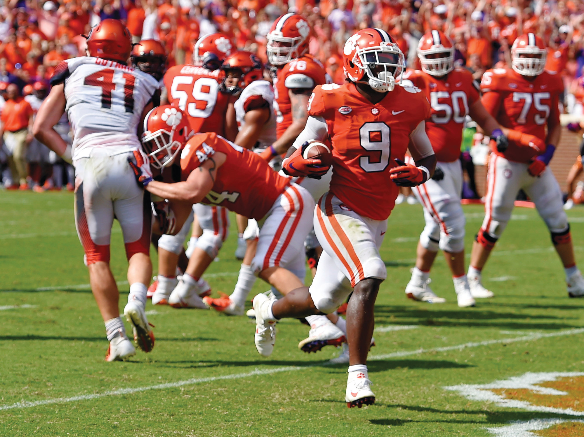 Clemson running back Travis Etienne (9) scores the winning touchdown in the Tigers' 27-23, come-from-behind victory over Syracuse on Saturday at Memorial Stadium in Clemson.