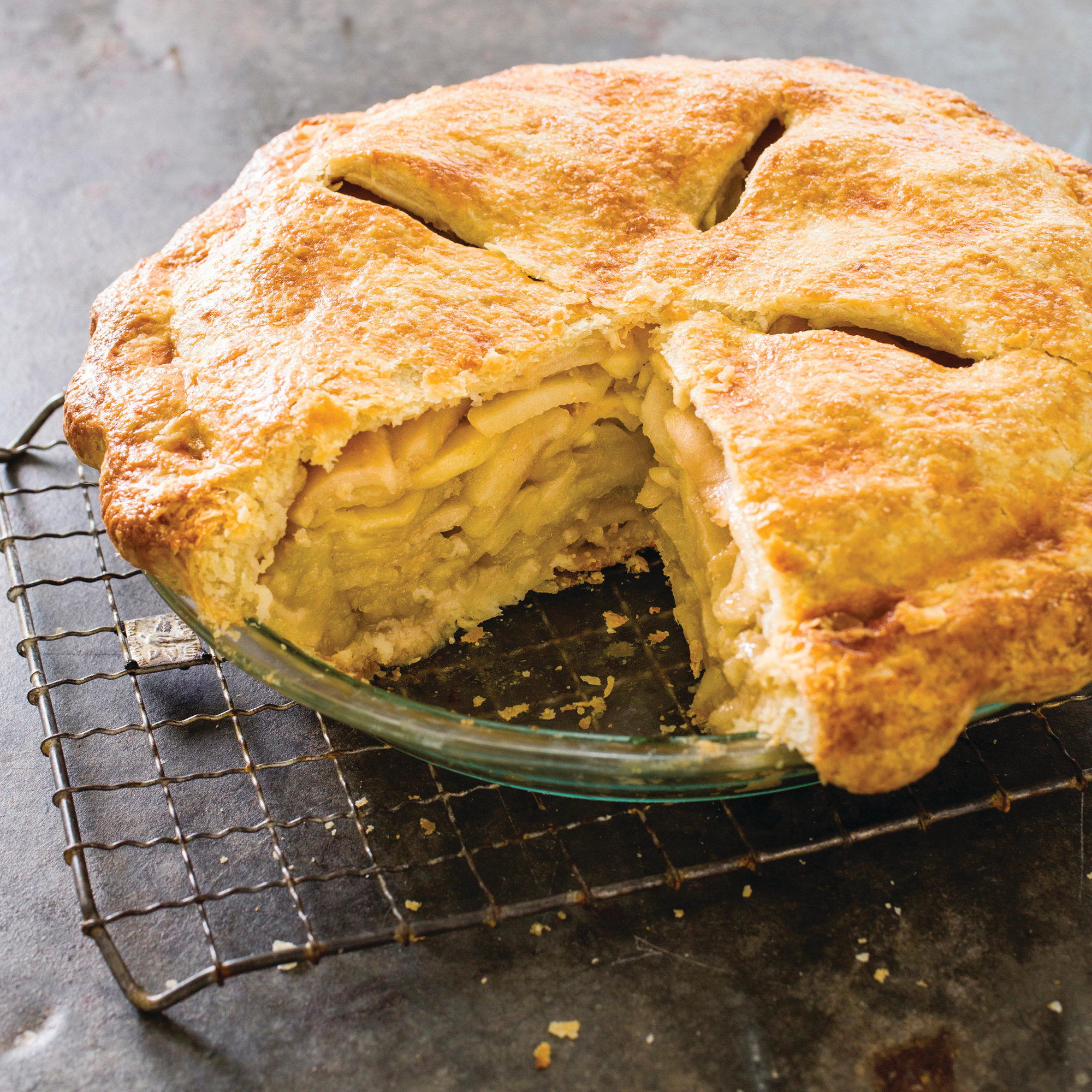 "This undated photo provided by America's Test Kitchen in September 2018 shows a deep dish apple pie in Brookline, Mass. This recipe appears in the cookbook ""All-Time Best Holiday Entertaining."""