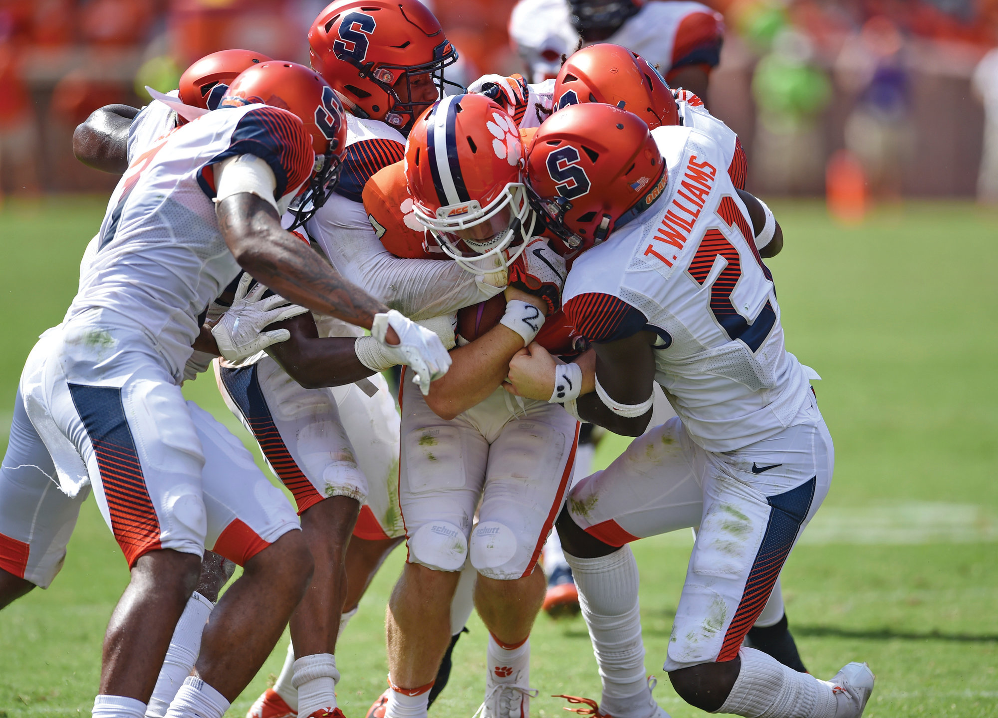 THE ASSOCIATED PRESSClemson quarterback Chase Brice (7) is tackled by Syracuse defenders after making a crucial first down on Saturday in Clemson. Clemson won 27-23.
