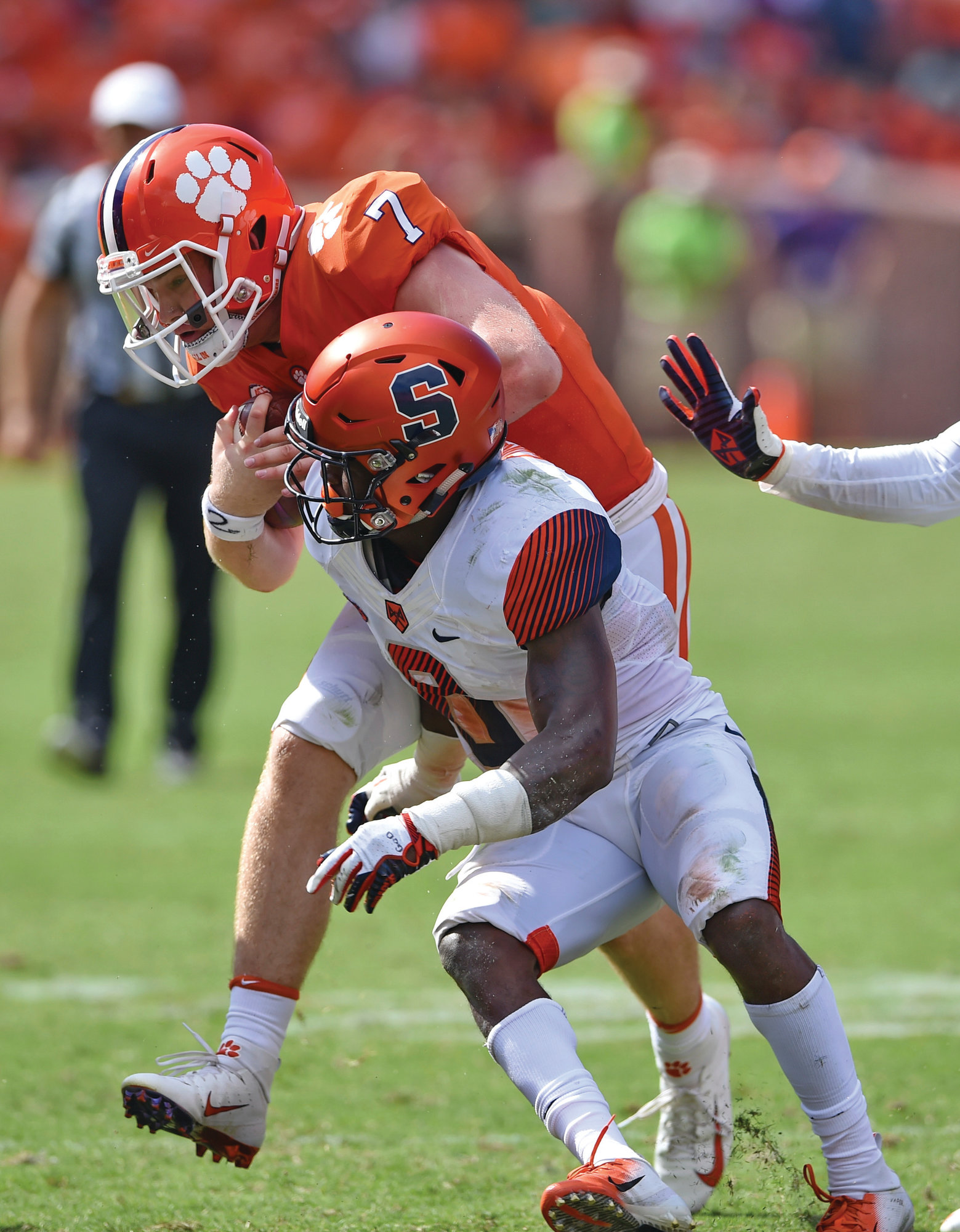 THE ASSOCIATED PRESSClemson quarterback Chase Brice (7) plows into Syracuse's Antwan Cordy after making a crucial first down on the winning drive in the Tigers' 27-23 triumph on Saturday in Clemson. The Tigers still aren't sure if starting quarterback Trevor Lawrence, injured on Saturday, will be available to play this Saturday against Wake Forest.