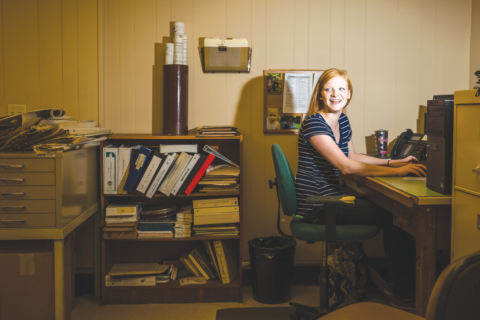 Kristen Nygaard sits at her desk Wednesday. Nygaard, 21, is the youngest employee in the City of Sumter Engineering Department. She got an associate degree at Central Carolina Technical College in Engineering Design Technology.
