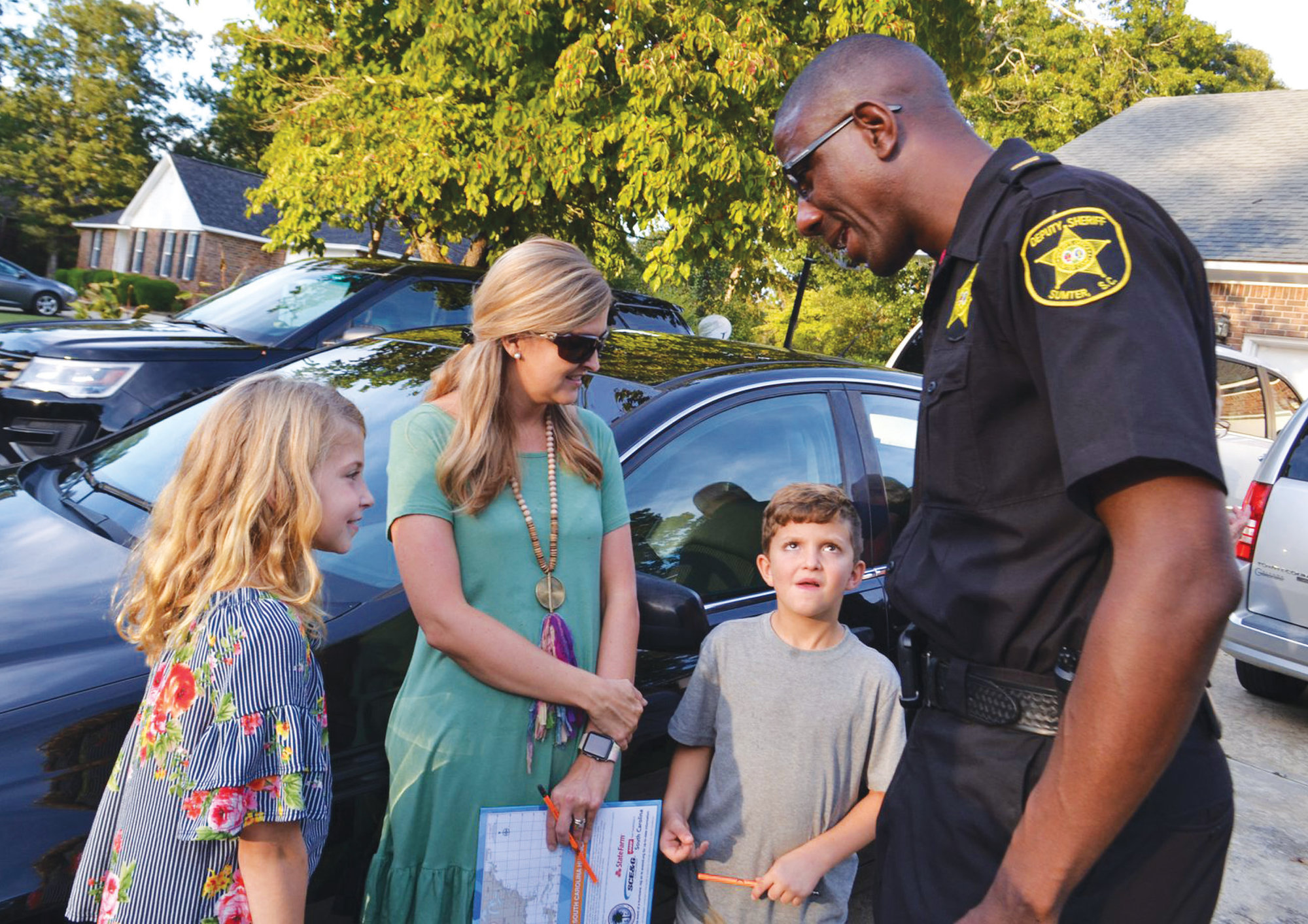 It takes a community: Sumter police, fire departments visit