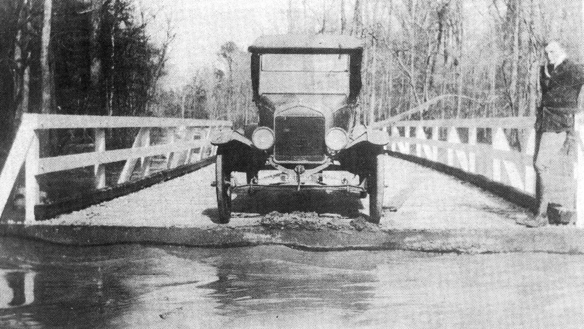 An early roadster waiting to be ferried across the Wateree River swamp in the early 20th century.
