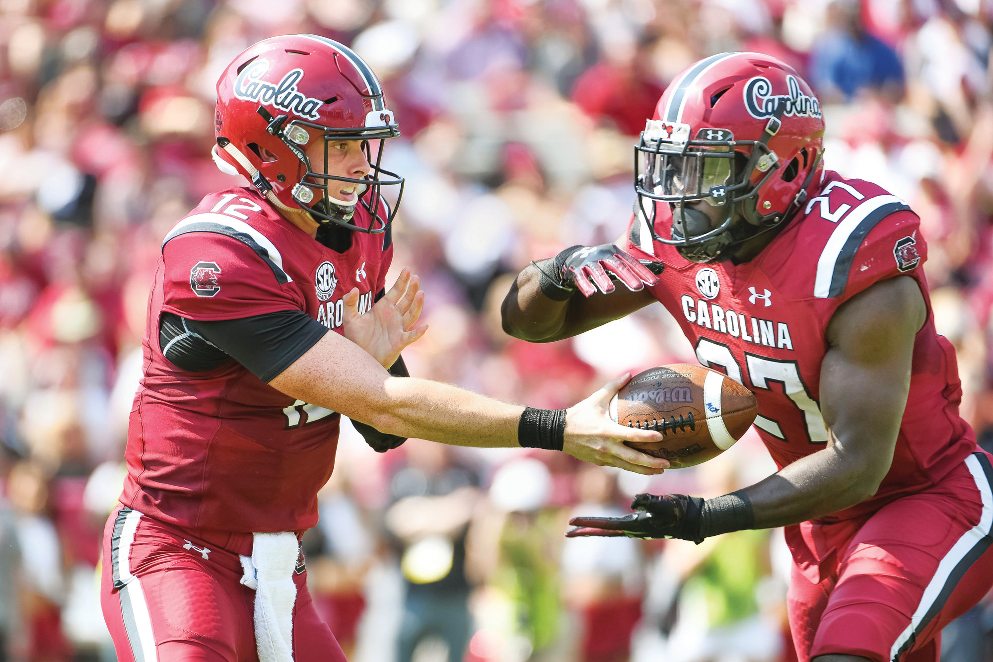 South Carolina quarterback Michael Scarnecchia (12) hands off to Ty'Son Williams (27) during the first half of an NCAA college football game against Missouri Saturday, Oct. 6, 2018, in Columbia, S.C. (AP Photo/Sean Rayford)